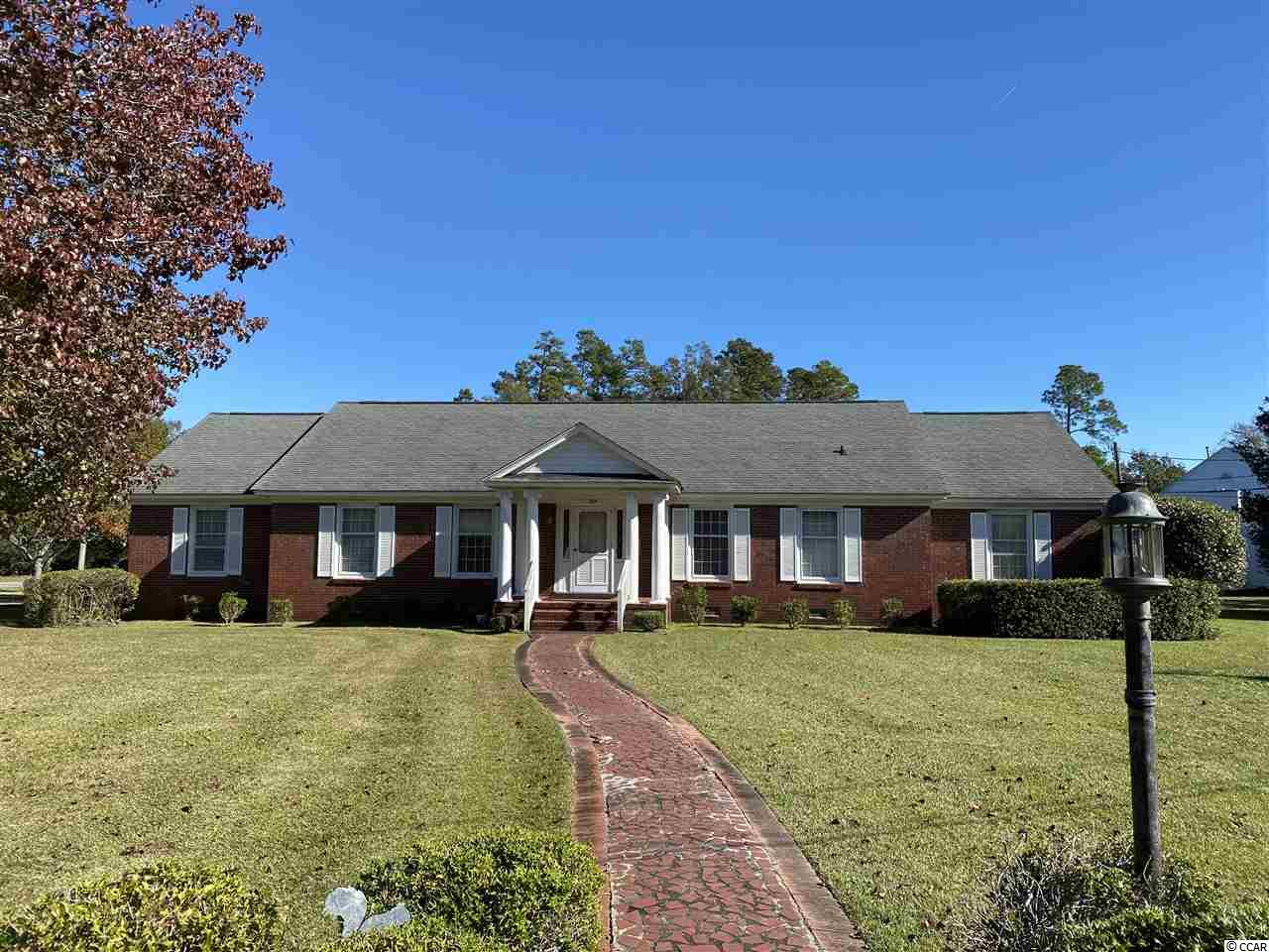 Attention to all those who have been looking for the older home to remodel and make it a show place. Endless possibilities with this ideal location and size.  All brick on a large corner lot.  Located across the street from Conway Elementary School. Don't delay in coming to see this one.