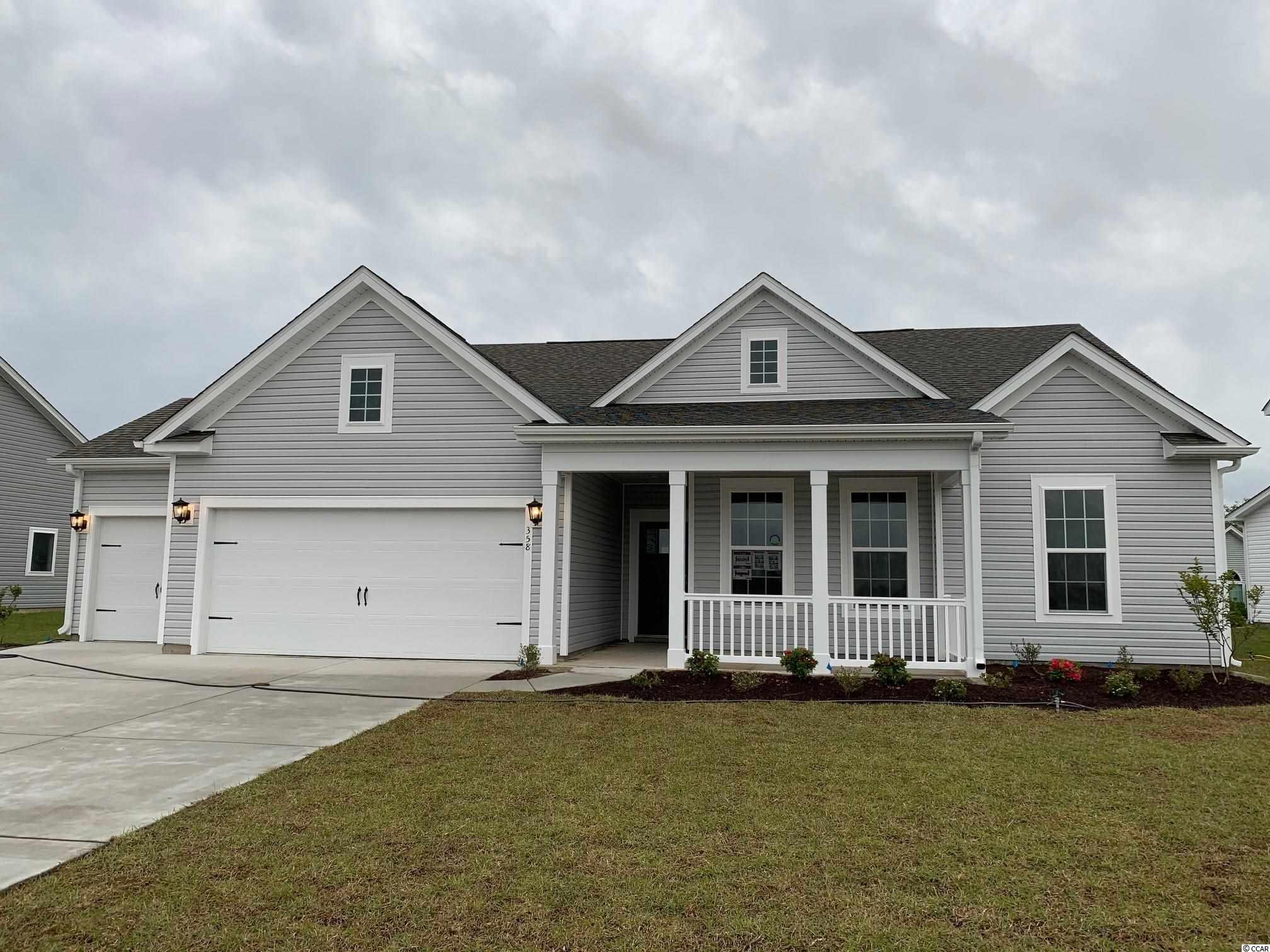 This Oxford-TRL home is pending with options personalized by the buyer, but we can build a home for you in 4.5-5 months!  Come see our decorated showcase-model homes Monday 1-5, Tuesday to Saturday 9-5, Sunday 12-5.  This Oxford-TRL (Traditional elevation) home includes a covered porch, 3-car garage, 3 bedrooms, 2 baths, and a study.  The kitchen is open to the Great room which boasts a vaulted ceiling.  Bedrooms 2 and 3 are privately located away from the Primary bedroom which is equipped with a bay window.  Awesome included features:  Daltile 12x12 tile in all baths and laundry room, the Primary bath includes a tile walk-in spa shower with a rain shower head and wall shower head, the Kitchen and both Baths feature white Master Brand Brellin cabinets, Granite kitchen counter tops, Level 2 Kitchen backsplash, Whirlpool kitchen appliances and washer/dryer, a lovely glass 3-Panel front door, upgraded Mohawk carpet in Bedrooms 2 and 3, Mohawk REV Wood flooring in all living areas and the Primary Bedroom, ceiling fans were added to the Primary bedroom, Great room, and Breakfast nook, Progress Lighting Staunton Pendants lights add flair over the spacious kitchen island, attic storage with pull-down stairs and a 24x24 utility sink in the garage, and a 10x12 patio pad off the covered porch.  All Belle Mer homes are Energy Star Certified.  Belle Mer offers amenities galore: pool, clubhouse, exercise room, sidewalks, fishing and non-motorized boating lakes, weekly curbside trash collection, and a premier location between Myrtle Beach and Murrells Inlet.  Just 3 miles to the beach, but across the street from 3 large shopping and dining venues (South Strand Commons, Super Target, and Super Walmart).