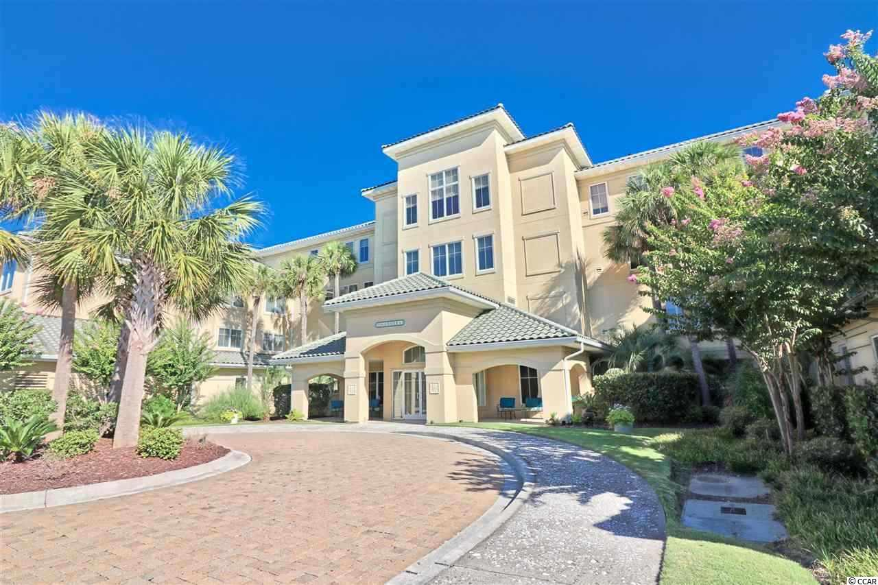 Located in the gated community of Edgewater in Barefoot Resort, this three bedroom, two bath unit overlooks hole 15 of the Greg Norman golf course. Enjoy the tranquil views from both bedrooms and the screened balcony. This nicely furnished unit has a split bedroom floor plan and a spacious galley kitchen and living area. Also, this unit has plenty of storage space with 2 storage closets--one in the hallway outside the unit and a larger one in the garage. There is an assigned parking space in the garage for this condo as well. Edgewater has its own clubhouse with a gym, hot tub, and fantastic pool area overlooking the Intracoastal Waterway. Come and enjoy all the amenities Barefoot Resort has to offer--four championship golf courses, large practice facility/driving range, onsite restaurants, Barefoot marina, private beach cabana with private parking for owners, and shopping boutiques located in Barefoot Landing.