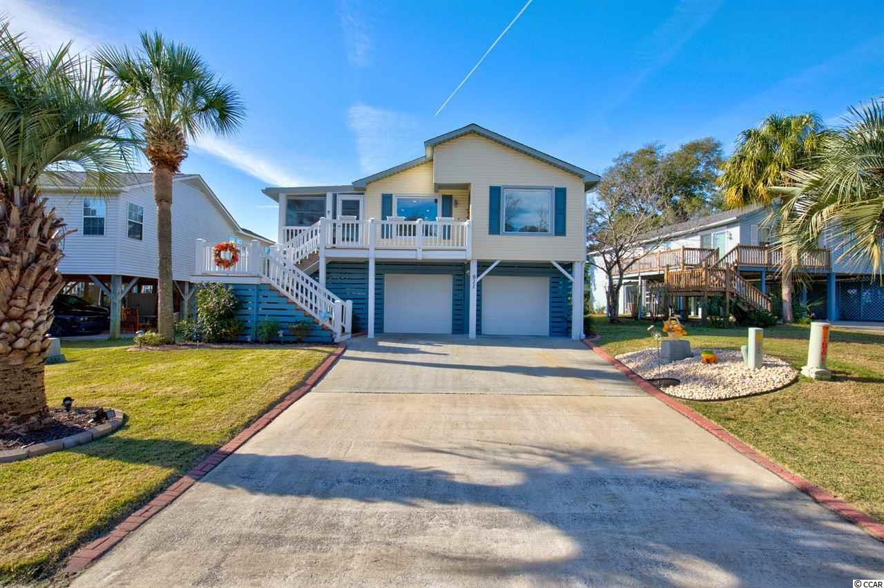 Tucked away updated 3 bed 2 bath raised beach home located in Salters Cove a golf cart ride to beach. Custom Kitchen with updated appliances, soft close cabinets and gorgeous granite countertops. Barn door entrance to Laundry room with custom cabinets ,pantry & stackable full size washer & dryer. Guest Bath remodeled with quartz counter, glass encased shower with pebble shower floor. Tile flooring modeled after the Boardwalk in Myrtle Beach in all areas except Bedrooms. All newer LED lit fans and Smart Home features. Enclosed deck off of kitchen with a 2018 Mini split for added cooled living space including gorgeous furniture for enjoyable entertaining. Outdoor Shower, outdoor Kitchen includes smoker, grill , large sink installed with Porcelain Tile and room for 4 cars and golf cart enclosed in garage. 2 storage room areas one for workshop and other includes Fridge & shelving. LOW HOA's Amenities include pool, clubhouse, fishing cove, playground, tennis & pickle ball courts. Close to beach, pier, golfing, Murrell's Inlet Marsh walk restaurants and Myrtle Beach entertainment. Square footage is approximate and not guaranteed. Buyer is responsible for verification.
