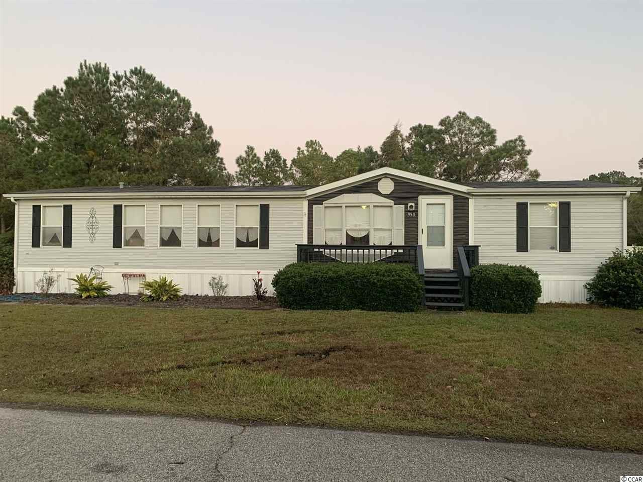 Absolutely gorgeous 3 bedroom 2 bath double wide manufactured home on a large corner lot with a private view off of the back deck. This popular community of Conway Plantation is just minutes away from beaches, waterways, local shopping and Carolina Forest High School. Interior is complete with a private laundry area that leads into a spacious kitchen with plenty of cabinet space for storage a beautiful large island with the ability to add breakfast seating on the other side. Off of the kitchen is a large living room complete with an elegant fireplace that leads to the back deck with a private view perfect for quiet mornings. Off of the rear deck is a bonus room that can be used for multi-purposes, this incredible bonus space is sound proof and set up with different lighting options. Home is also complete with two very spacious bedrooms that share a full bathroom as well as a large master bedroom with a walk in closet and very spacious master bathroom that is complete with a large soaking tub. The rear of the home also contains 2 storage sheds for all of your additional storage needs! Don't miss this beauty it won't last long at this price!!