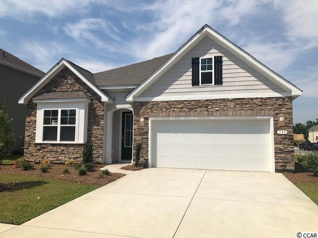 New phase now selling! Hidden Brooke is a beautiful community with an amenity that includes a pool with large deck area, clubhouse, exercise room, and fire pit overlooking the water. Minutes away from Highway 31 which provides quick and easy access to all of the Grand Strand's offerings: dining, entertainment, shopping, and golf! Tranquil setting just a short drive to the beach. This Claiborne plan features a craftsman style exterior with arched entryway, shake, and stone accents, and a beautiful open concept interior layout. The kitchen boasts granite countertops, an oversized island, white painted cabinets, a walk-in pantry, and stainless Whirlpool appliances. The large primary bedroom suite is tucked away at the back of the home, separated from the other bedrooms, with a double vanity and 5' shower along with a huge walk-in closet and separate linen closet. Beautiful laminate wood floors run throughout the foyer, kitchen, living, and dining rooms with tile in the bathrooms and laundry room. It gets better- this is America's Smart Home!  Control the thermostat, front door light and lock, and video doorbell from your smartphone or with voice commands to Alexa.  *Photos are of a similar Claiborne home.  (Home and community information, including pricing, included features, terms, availability and amenities, are subject to change prior to sale at any time without notice or obligation. Square footages are approximate. Pictures, photographs, colors, features, and sizes are for illustration purposes only and will vary from the homes as built. Equal housing opportunity builder.)