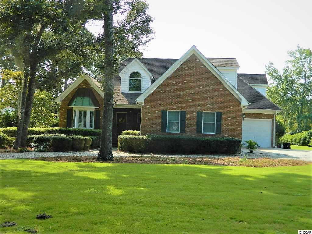 This beautiful home is located on Belle Isle lake with dock, great for fishing. Just minutes from Historic Georgetown and waterfront shopping and restaurants.  Features 9 ft. ceilings  spacious kitchen/ work island and  adjoining dinette and formal dining area.  Kitchen, great room, dinette and master bath with views of lake.  Deck also overlooks lake.  Master Bedroom with bay window, walk in closet and bath spa tub and shower on the ground floor.  2 bedrooms on second level with adjoining bath, office area and cedar lined closet with H/A in attic space.  Oak flooring, 1/2 bath and utility room. Double garage with attached workshop with bay door. Partial concrete floor under house with lighting.   Sprinkler system supplied by lake water. All measurements are approximate and should be verified by potential buyer.  Size of lot not exact and should be verified.