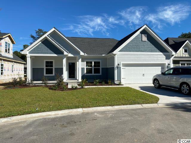The wait is over for this new phase of Pawleys Plantation. This is a to be built plan with the standard features pricing that is ready for your input on the options and colors.  The home includes granite countertops throughout, 9 foot ceilings, crown molding and tall baseboards, lawn irrigation and much more! All measurements are approximate and can be verified by Buyers Agent/Purchaser. This home is a Wisteria C Model. Don't miss this opportunity to own the home of your dreams in Pawleys Plantation!