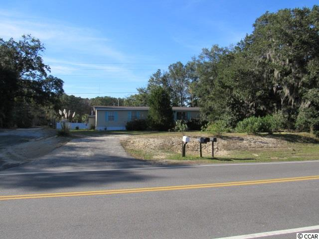 List Price is for the land. Older Manufactured home 3br 2ba is livable but no additional value given, SOLD AS-IS. Adjacent Sellers prefer to sell together. PINS 46903020005 & 46903020003 See adjacent MLS#2024971 See SCDOT Announcement regarding International and McDowell Shortcut intersection improvements.  Project Schedule Right of Way: Spring 2021 Construction: Summer 2022  https://scdot-environmental-project-site-scdot.hub.arcgis.com/pages/tournament-blvd-s-801-at-mcdowell-street-s-477-intersection-improvements-in-horry-county?previewing=true S-801 & S-477  Call Listing Agent with all questions. No showings of structure but included with sale.