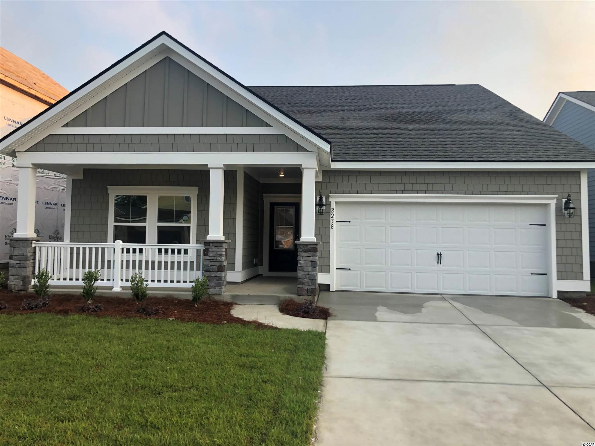 """Exciting Phase 5 homes underway! Gorgeous 3 bedroom with large kitchen with granite countertops in the amazing Market Common community!. The World's First Wi-Fi CERTIFIED Home Designs!  Featured home is The St. Phillips Model. Very poplular FLOOR PLAN! This home boasts southern charm. Check out our new floor plans. Come sit and relax on the big front porch and enjoy our resort style amenities!  Belle Harbor (A Coastal Lifestyle Community) is nestled in the pristine Community of Market Commons. It will feature 400 beautiful homesites backing up to woods and pond views. With a selection of homes ranging from 1772 to 2899 heated square feet, they're flexible enough to meet any family's needs. These homes will feature our """"Everything's Included"""" package which includes many upgrades such as HardiPlank® siding, granite countertops, tiled backsplash, Frigidaire stainless steel kitchen appliances and upgraded cabinets in the kitchen. Tile flooring in baths / laundry room and a tankless water heater (Rinnai). Also includes a gas range, 2 car garage and a covered lanai for outdoor living enjoyment. There is so much to discover in this diverse and intriguing area. (1.5 miles to the beach). Short Golf Cart ride to shopping, restaurants, and the beach.  We invite you to surround yourself with natural beauty and find how living the Belle Harbor lifestyle may be perfect for you. Some pictures may include upgrades. Buyer responsible for verification of all measurements."""