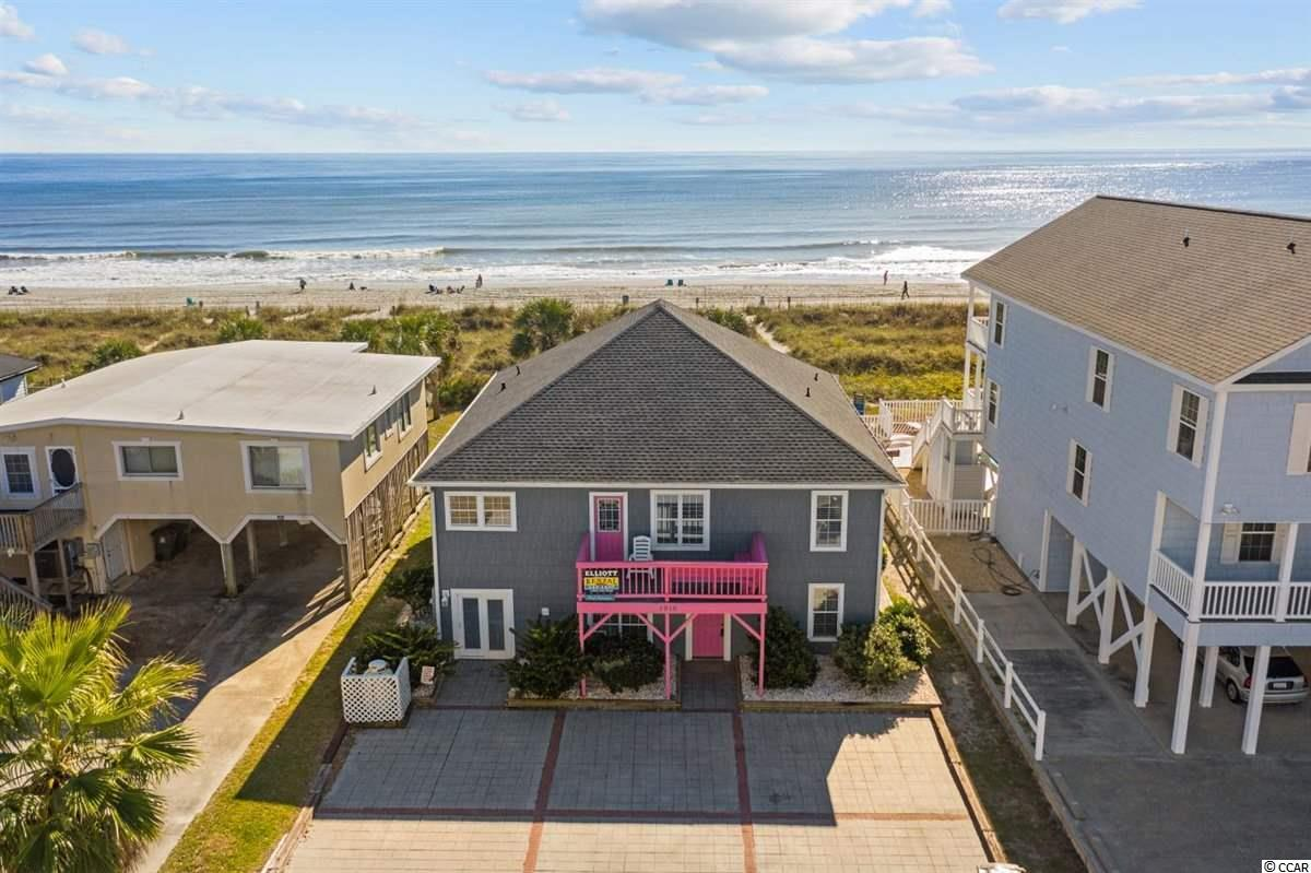 Welcome to A Pink Paradise!  This direct oceanfront home is located in the heart of Cherry Grove Beach and only steps to restaurants and shopping.  A unique property that can be used as a single home or as a duplex with private entry on both levels.  There is a strong rental history and tremendous future investment potential for this home.  Each level offers a kitchen, living area, five bedrooms and three baths.  In total the home sleeps 20 guests.  The property is sold with all furnishings and appliances.As you enter on the ground floor level, you'll find a large and open kitchen and living space.  The kitchen has been upgraded with granite countertops and newer appliances.  New lighting and plumbing fixtures have been recently installed.  Tile flooring is found throughout the ground level for easy maintenance.  Multiple patio doors lead out from the living areas and master suite to enjoy the oceanfront outdoor space and covered patio.  As you take the stairs to the upstairs level, the breathtaking ocean views will blow you away.  Two master suites and living area have a prime viewing location for the beautiful Atlantic Ocean.  All have access to the rear deck to take in the ocean breeze.  The upper level also has a kitchen, dining, five bedrooms, and three baths.  Both levels have additional flex space for more seating options or living space.  This property has many other upgrades included.  New furnishings have been added throughout.  Bathrooms have been upgraded with newer vanities and some additional tile work has been completed.  All bedrooms and living rooms have cable tv and mounted flat screen tvs.  A new gabled roof was added in 2017, two tankless gas hot water heaters are approximately three years old and all three HVAC systems were new in the last three years.   The exterior has low maintenance shake vinyl siding with vinyl replacement windows.  For beach access, their is a private walkway connecting the rear deck to the oceanfront.  There is also plenty of backyard outdoor space to enjoy lawn games.  This home can be used as a great investment property or a secondary home for large families.  All information is deemed reliable, buyer is responsible for all verification.