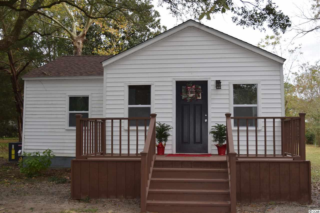 Excellent location near Winyah Bay on a nice lot with gorgeous trees.  This is the home you've been searching for with Southern charm and character.  The home has been beautifully renovated.  New roof, new HVAC and duct, new bathrooms, windows, doors, kitchen cabinets, flooring, and paint.  Room for boat or RV parking, carport, a big garden, shop or whatever your favorite pastime. Enjoy quiet evenings on the new front porch or explore the nearby Georgetown historic district.