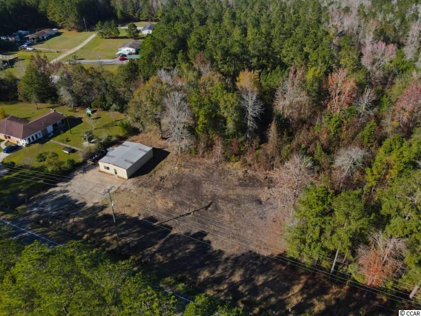 Don't miss out on this beautiful 8.84 acres of land! This land will include a newly renovated building that could be used for office space or storage. The building will have water, septic, a brand new air condition unit, new electric, a new bathroom and stucco on the outside. The parking lot will be completely redone as well. This land parcel is in a perfect location, located on Cultra Road, not too far from the lovely town of Conway.  Measurements are approximate and not guaranteed. Buyer responsible for verification.