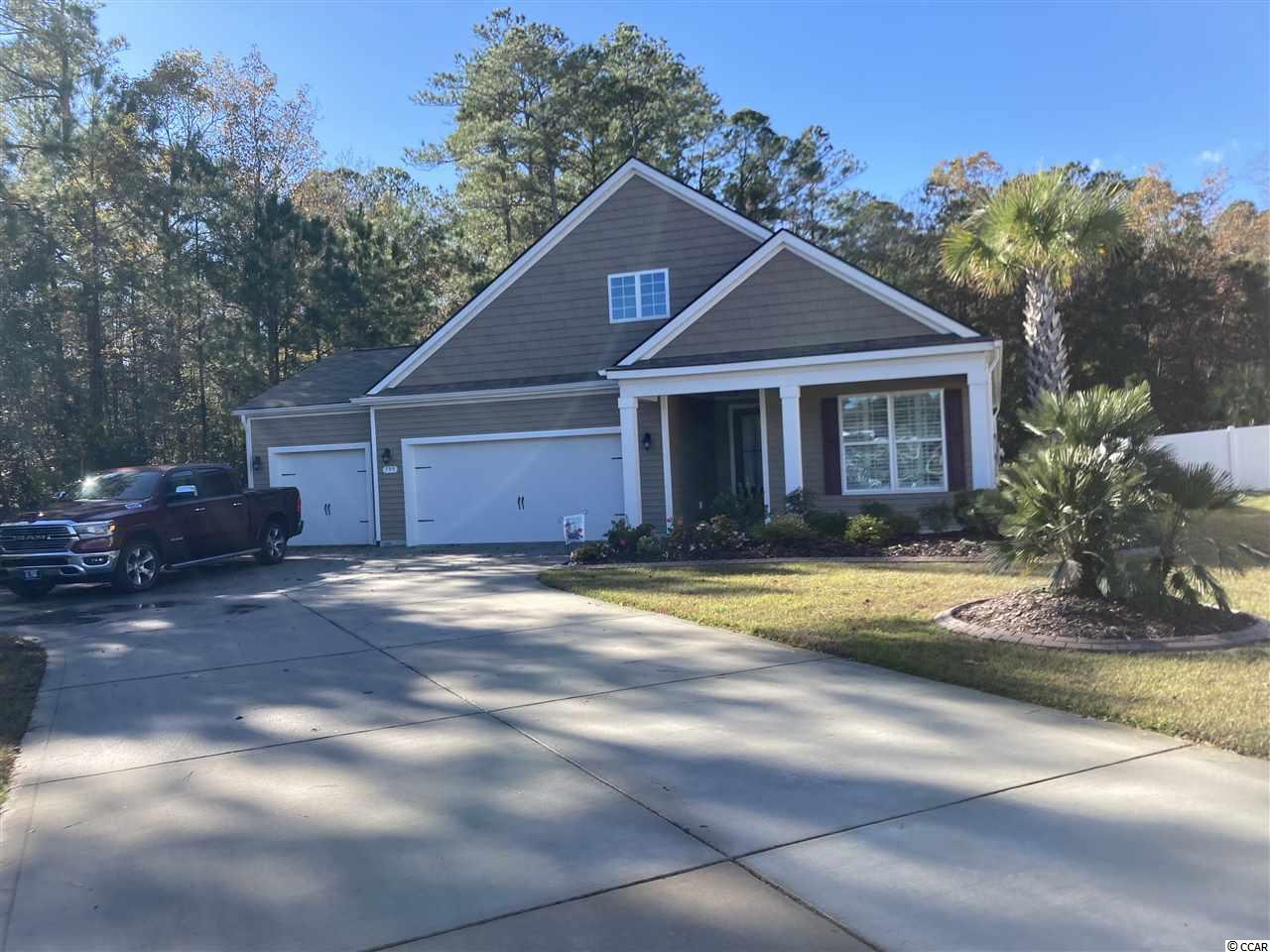 Welcome to this Outstanding 3/4 bedroom, 2 bath home in Carolina Crossing in the Little River area. The current homeowners had '11is home built by DR Horton in 2016. This spacious home with over 2100 heated s are feet features an open flowing floor plan hat is feat for entertaining. This home has 3BR's + a flex room that could be a 4th bedroom, man cave, craft area, etc. As you enter the home the two guest bedrooms will be on your right with a guest bathroom. The laundry area and flex room will be on the left, along with access to the 3-CAR GARAGE. In the main ' vin g area you'll find the great room area, kitchen and dining areas. Off he family room, there is a Sunroom option current used an an office. The kitchen features upgraded level 2 cabinets with bottom cabinet pull out trays, a pots and pans drawer, pendent lighting, a granite countertops. The spacious master bedroom has a tray ceiling, and the large master bath also has a tray ceiling, step in shower and linen closet. All bedrooms have carpeting, and the main living area, including the flex room all have engineered hardwood flooring.  All bathrooms, the kitchen, and  the sunroom have ceramic tile flooring.  The plantation shutters roughout the home are included in the sale. There is also a screened porch with EZ Breeze windows, and decorative concrete edging around all of the garden areas. Outside a large  patio runs across the rear of the home, and features very nice landscaping to include several palm trees, evergreen plantings, etc. The left side and rear of the very private backyard is surrounded by a conservation area. There is no flood insurance required for this property. All measurements are approximate and not guaranteed . Buyer is responsible for verification.
