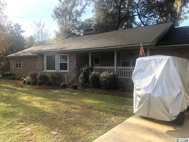 ENJOY 5-minute golf cart rides to the BEACH on historic Pawleys Island from this updated 4br /3ba custom brick ranch home located on a corner lot in Gray Mans Cove. Recently remodeled (2018-2019), it has an enclosed oversized back yard, great for family and friends. This split bedroom plan offers 2 bedrooms at each end of the home, with updated kitchen, living, and dining in an OPEN FLOOR PLAN, with double-side woodburning Fireplace. The owners bedroom has a brand new bathroom w walk-in tiled shower. Home also has wood flooring throughout, large bedrooms, and plenty of light. Enjoy the new decks off the rear side of the home featuring synthetic plank flooring. Other recent upgrades include a new roof (2018) and 2 new tankless gas hot water heaters (2020). Move in Ready! Imagine all the fun activities of Pawleys Island - boating, fishing, kayaking, paddle boarding, surfing, sun bathing, skiing in the river, golf, dining and friends - all within minutes from your home! Close proximity to great golf courses (6 public within 4 miles), restaurants, grocery stores, shopping, and only 75 miles from the historic port city of Charleston. All measurements are approximate and should be verified by buyer.