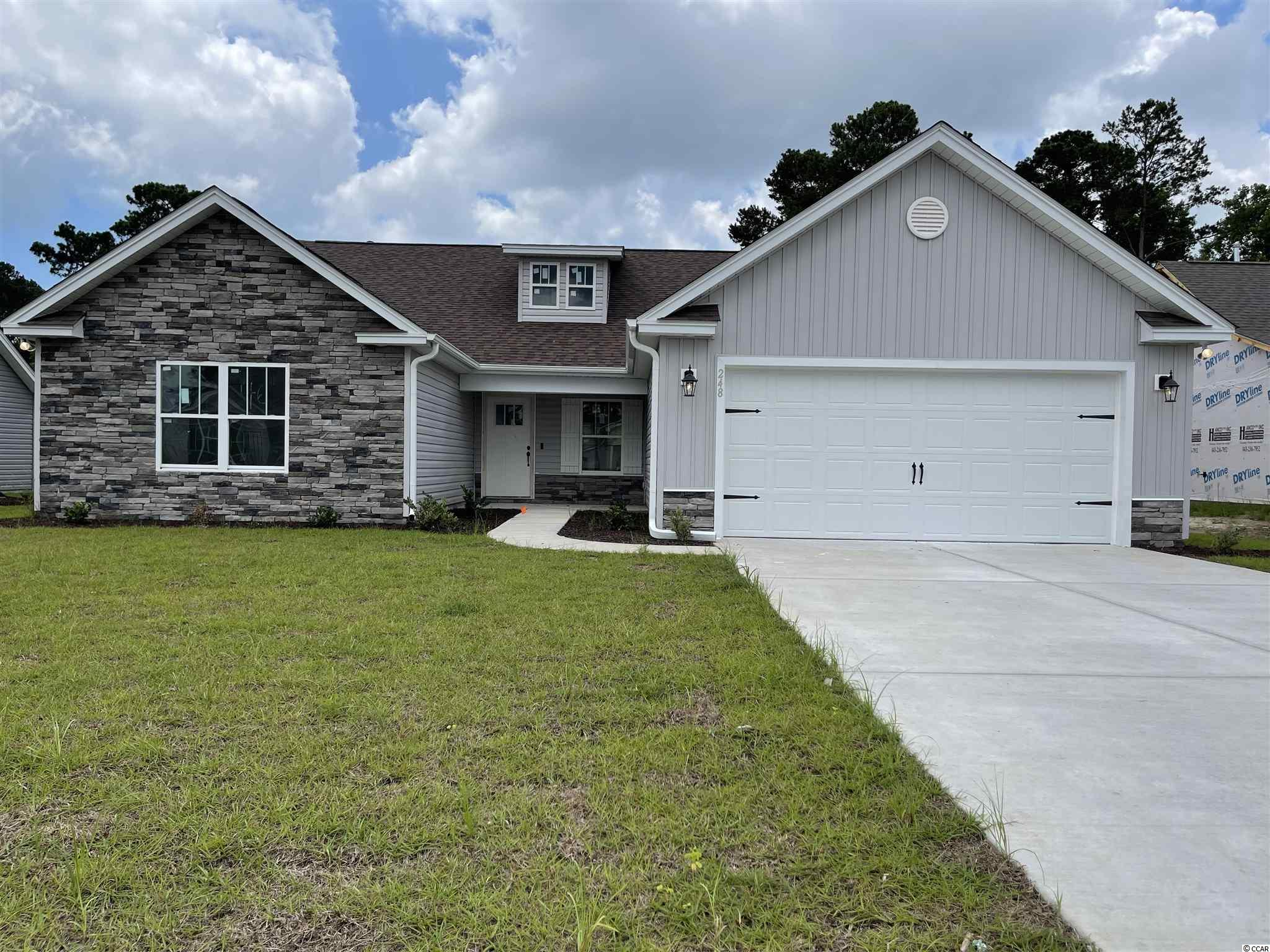 "Natural Gas quiet community located in Little River/North Myrtle Beach only a few miles from the Beach and major shopping! This is the Tanzanite floor plan. Spacious open floor plan on a 0.20 ac home site featuring 3 bedrooms, 2,5 baths. This home includes finished 2 car garage, and a large rear porch!! Ceramic tile in all bathrooms and Laundry room, LVP flooring in Family Room, Foyer, Hall, Dining. Granite Kitchen Countertops, crown molding on kitchen cabinets with hardware included. Vaulted ceiling in Family room and every bedroom. Wainscot and 5 1/2 "" beaded baseboards for Custom look!! Home also includes TAEXX pest control tubing, lawn irrigation and Ring video doorbell!!! Stone accents on the exterior as well. All measurements are approximate *Photos of a similar home* Some items on the photos may be an additional cost. Anticipating completion time Summer 2021"