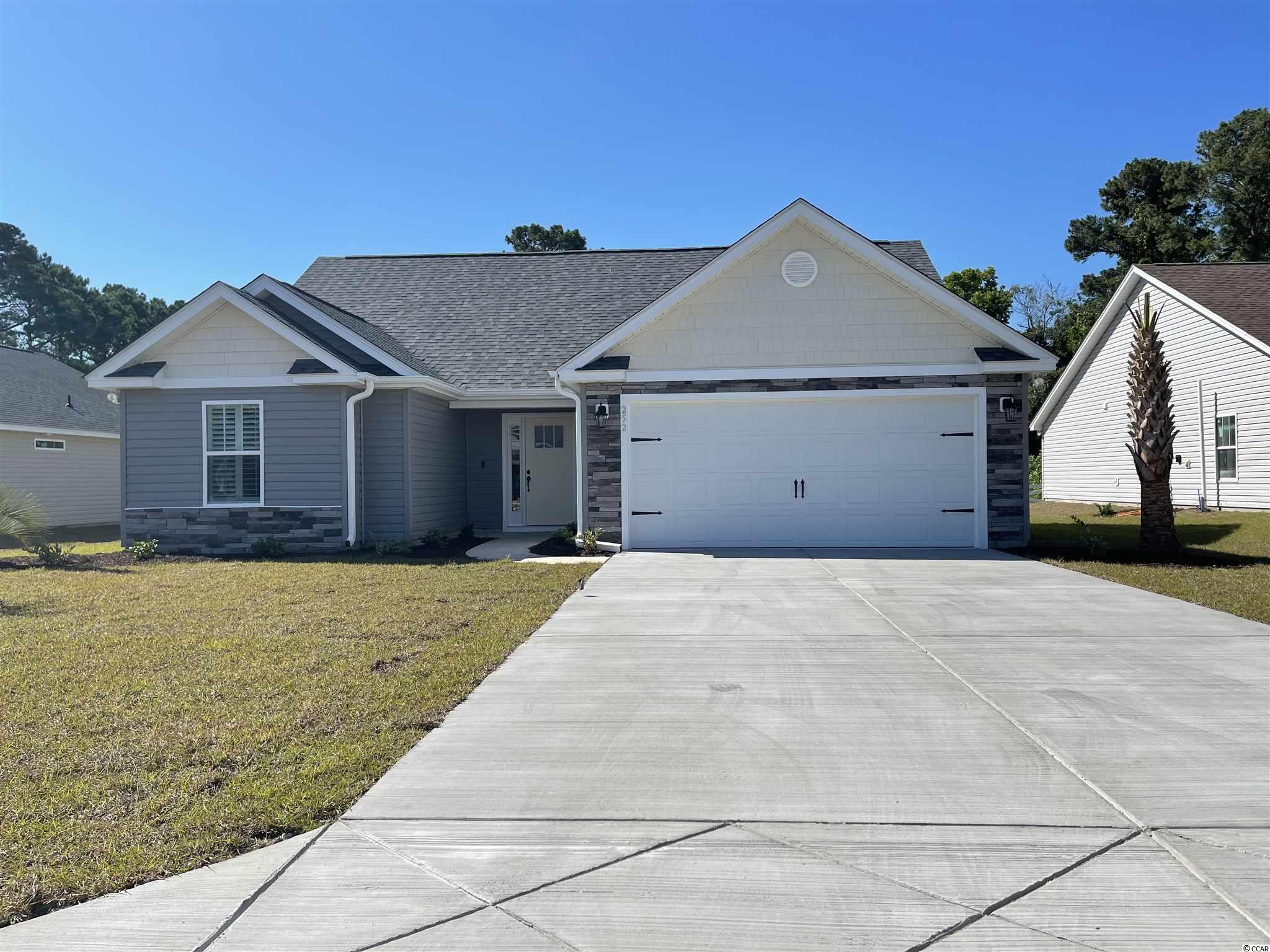"""Natural Gas quiet community located in Little River/North Myrtle Beach only a few miles from the Beach and major shopping! This is the Opal floor plan. Open floor plan on a 0.20 ac home site featuring 3 bedrooms, 2 baths. This home has a 2 ft expansion through center. It includes a finished 2 car garage with laundry room moved inside. Ceramic tile in all bathrooms and Laundry room, LVP flooring in Family Room, Foyer, Hall. Granite Kitchen Countertops, crown molding on kitchen cabinets with hardware included. Vaulted ceiling in Family room and every bedroom. Wainscot and 5 1/2 """" beaded baseboards for Custom look!! Home also includes TAEXX pest control tubing, lawn irrigation and Ring video doorbell!!! Stone accents on the exterior as well. All measurements are approximate *Photos of a similar home* Some items on the photos may be an additional cost. Anticipating completion time March-April 2021"""