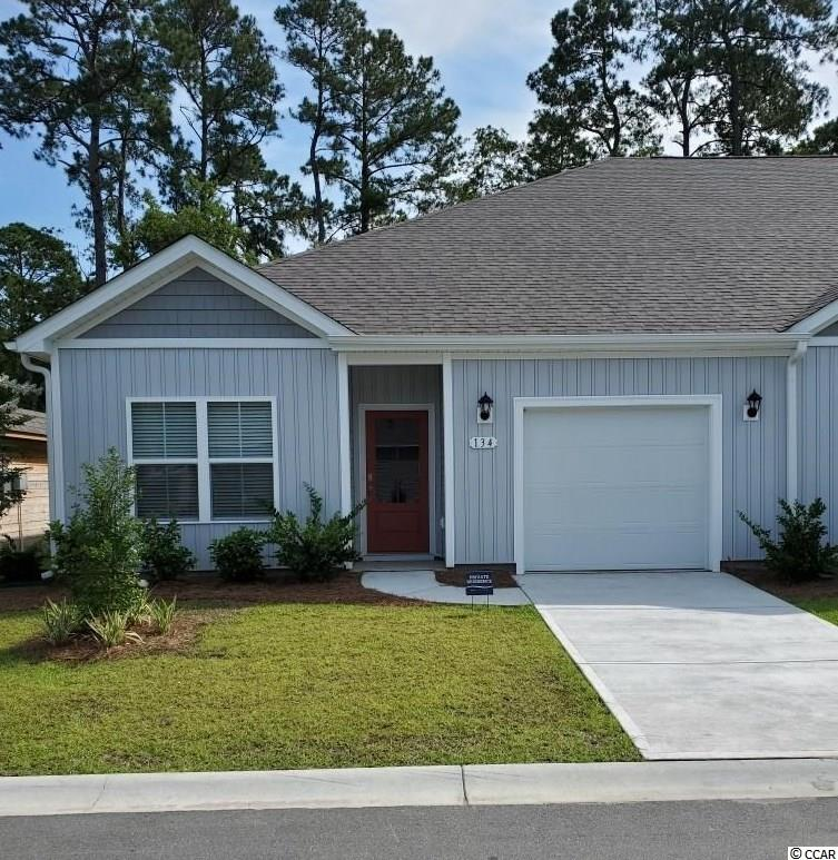 Brand new community within walking distance to the Murrells Inlet Marsh Walk! Low maintenance living at its best with these single level townhomes. This Bentley floorplan is an end unit and boasts an open concept kitchen, living, and dining area along with three spacious bedrooms! Features include white painted cabinetry, granite counters in the kitchen, stainless Whirlpool appliances, and laminate wood flooring that flows throughout the main living areas. The primary bedroom suite has a walk-in closet along with a private bathroom with dual vanity and large shower. Enjoy the beautiful coastal weather on the rear covered porch! 1-car garage with garage door opener plus a spacious storage closet off the rear porch. It gets better- this is America's Smart Home! Ask an agent today about our industry leading smart home technology package that is included in each of our homes.  *Photos are renderings of the Bentley floorplan. This home is under construction. (Home and community information, including pricing, included features, terms, availability and amenities, are subject to change prior to sale at any time without notice or obligation. Square footages are approximate. Pictures, photographs, colors, features, and sizes are for illustration purposes only and will vary from the homes as built. Equal housing opportunity builder.)