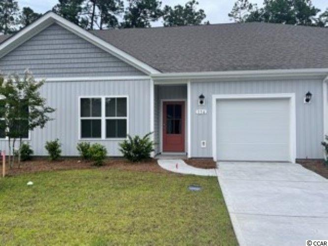Brand new community within walking distance to the Murrells Inlet Marsh Walk! Low maintenance living at its best with these single level townhomes. Our Bentley floorplan is masterfully designed with an open concept kitchen, living, and dining area that is perfect for guests visiting you at the beach! Features include modern gray painted cabinetry, granite counters in the kitchen, stainless Whirlpool appliances, and laminate wood flooring that flows throughout the main living areas. This home also boasts a versatile flex space that would make a great formal dining room or home office. The primary bedroom suite is tucked away at the back of the home with a walk-in closet along with a private bathroom with dual vanity and large shower. Enjoy the beautiful coastal weather on the rear screened porch! One-car garage with garage door opener plus a spacious storage closet off the rear porch. It gets better- this is America's Smart Home! Ask an agent today about our industry leading smart home technology package that is included in each of our homes. Blinds were also added throughout the home.  *Photos include renderings of the Bentley floorplan. This home is under construction. (Home and community information, including pricing, included features, terms, availability and amenities, are subject to change prior to sale at any time without notice or obligation. Square footages are approximate. Pictures, photographs, colors, features, and sizes are for illustration purposes only and will vary from the homes as built. Equal housing opportunity builder.)