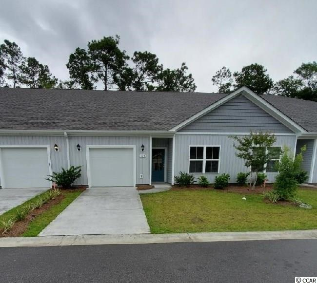 Brand new community within walking distance to the Murrells Inlet Marsh Walk! Low maintenance living at its best with these single level townhomes. Our Bentley floorplan is masterfully designed with an open concept kitchen, living, and dining area that is perfect for guests visiting you at the beach! Features include white painted cabinetry, granite counters in the kitchen, stainless Whirlpool appliances, and laminate wood flooring that flows throughout the main living areas. This home also boasts a versatile flex space that would make a great formal dining room or home office. The primary bedroom suite is tucked away at the back of the home with a walk-in closet along with a private bathroom with dual vanity and large shower. Enjoy the beautiful coastal weather on the rear covered porch! 1-car garage with garage door opener plus a spacious storage closet off the rear porch. It gets better- this is America's Smart Home! Ask an agent today about our industry leading smart home technology package that is included in each of our homes.  *Photos include renderings of the Bentley floorplan. This home is under construction. (Home and community information, including pricing, included features, terms, availability and amenities, are subject to change prior to sale at any time without notice or obligation. Square footages are approximate. Pictures, photographs, colors, features, and sizes are for illustration purposes only and will vary from the homes as built. Equal housing opportunity builder.)