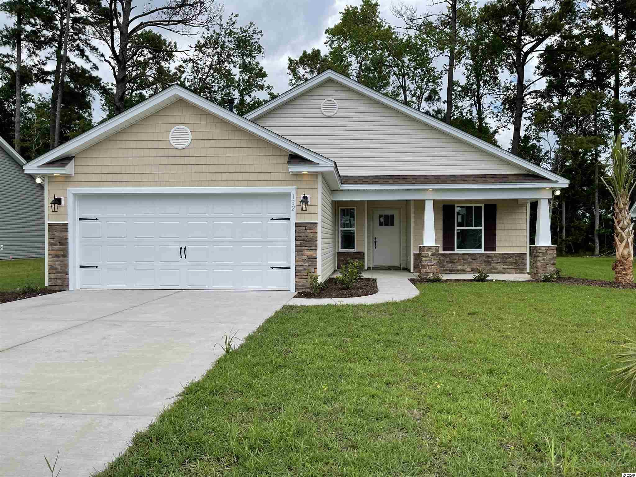 """Natural Gas quiet community located in Little River/North Myrtle Beach only a few miles from the Beach and major shopping! This is the Ruby floor plan  built on a 0.20 ac home site. This home includes finished 2 car garage, a covered rear patio and a covered front porch!! Spacious and open kitchen with lots of counter space, granite countertops, White shaker kitchen cabinets with crown molding and hardware included. 5 ft cultured marble shower and a garden tub in Master bathroom, large walk in master closet. Ceramic tile in all bathrooms and Laundry room, LVP flooring in Family Room, Foyer, Hall, Dining. Vaulted ceiling in Family room and every bedroom. Wainscot and 5 1/2 """" beaded baseboards for Custom look!! Home also includes TAEXX pest control tubing, lawn irrigation and Ring video doorbell!!!Stone accents on the exterior as well. All measurements are approximate *Photos of a similar home* Some items on the photos may bean additional cost. Anticipating completion time Summer 2021"""