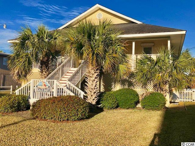 """This never-rented home is nestled between a deep water channel of Murrells Inlet and the Atlantic Ocean - your access directly across the street, allowing for """"South Carolina Trade Winds"""", all the time - the thing that increases life expectancy.  This true beach cottage will be loaded with memories before long and the smell of salt air, mixed with Old Bay, will carry the evening.  The beach you will use has 3-4 rows deep of dunes and this is important to your value!  Along the rear is your private creek access by boat, from the covered stationary dock, floating dock for boat tie-up and from the 20,000 lb. boat lift.   From your back door, shrimp, crab, hop into your boat and go out into Murrells Inlet, the Ocean or to dinner along the Murrells Inlet Marsh Walk, where there's always a place to tie up for dinner.  Come see."""