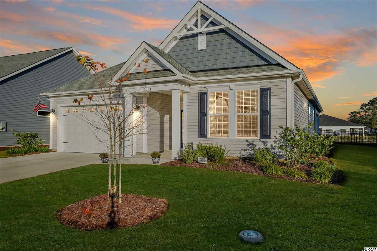 """Come home to """"The Good Life"""" in Bridgewater, a Chesapeake Homes community in Little River, SC! Location is perfect to enjoy living in a tranquil surrounding while enjoying ponds and lakes and a variety of waterfowl. Check out the amenities this community offers and the social life with the monthly calendar of events to join. Just over the ICW bridge in North Myrtle Beach into Little River. Plan to preview this 3BR/2BA ranch home soon before it's too late. The Shorebreak model is inviting as soon as you step inside the foyer and into the large great room flowing into the kitchen with  island, granite countertop, large pantry, stainless steel appliances, and gas range. Master bedroom features trey ceiling with crown molding and huge walk in closet. Master bath upgrades offer walk-in tiled shower with bench and double sinks. Tankless water heater and gas furnace are featured in this natural gas community.  As an added feature, enclosed all season room with separate HVAC unit to enjoy added square footage and year round living with a view of spacious fenced backyard. Rainbows have also been seen  several times after an evening shower. Schedule a preview today and take advantage of a rare opportunity in Bridgewater!   Square footage is approximate and not guaranteed. Buyers responsible for verification."""