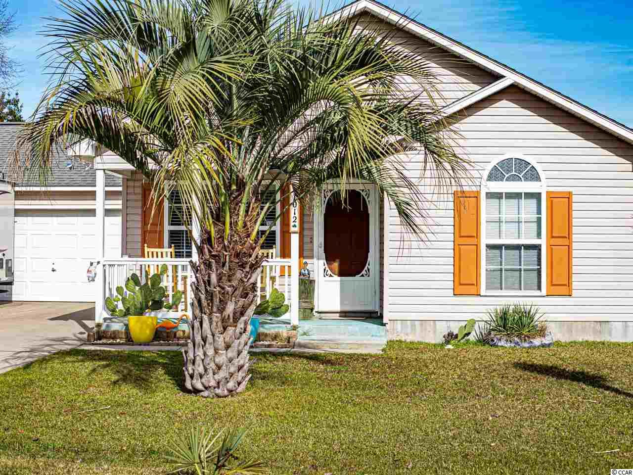 Magnificent!!! Welcome to your new beach home! Enjoy your morning coffee or evening cocktail from your own screened in back porch. This 4 bedroom, 2 bath home has only had one owner, and has been lovingly cared for. New HVAC in 2018! Palm Tree carvings decorate the concrete steps leading to the front porch. The living room boasts beautiful wood-look laminate flooring, upper wall decorative cutout nook, plantation shutters, and a stunning refinished knotty pine accent wall, reclaimed from a historic home renovation in downtown Conway. The same knotty pine continues in the wainscoting throughout the dining room. Beautiful blue country style cabinets compliment the gorgeous blue speckled pattern in the stunning freestanding quartz kitchen counters. The sliding glass doors in the dining area are new, and have been outfitted with plantation shutters. 6 ft white vinyl privacy fencing surrounds the back yard area and the 6x8 aluminum detached storage, making the yard perfect for pets and a private oasis for the pool. The home is outfitted with many additional features, including a whole home surge protector, located in the main electrical box. Pines of St. James is located in the highly desirable St. James school district, and has low HOA dues! Schedule your showing today. This home will not last!