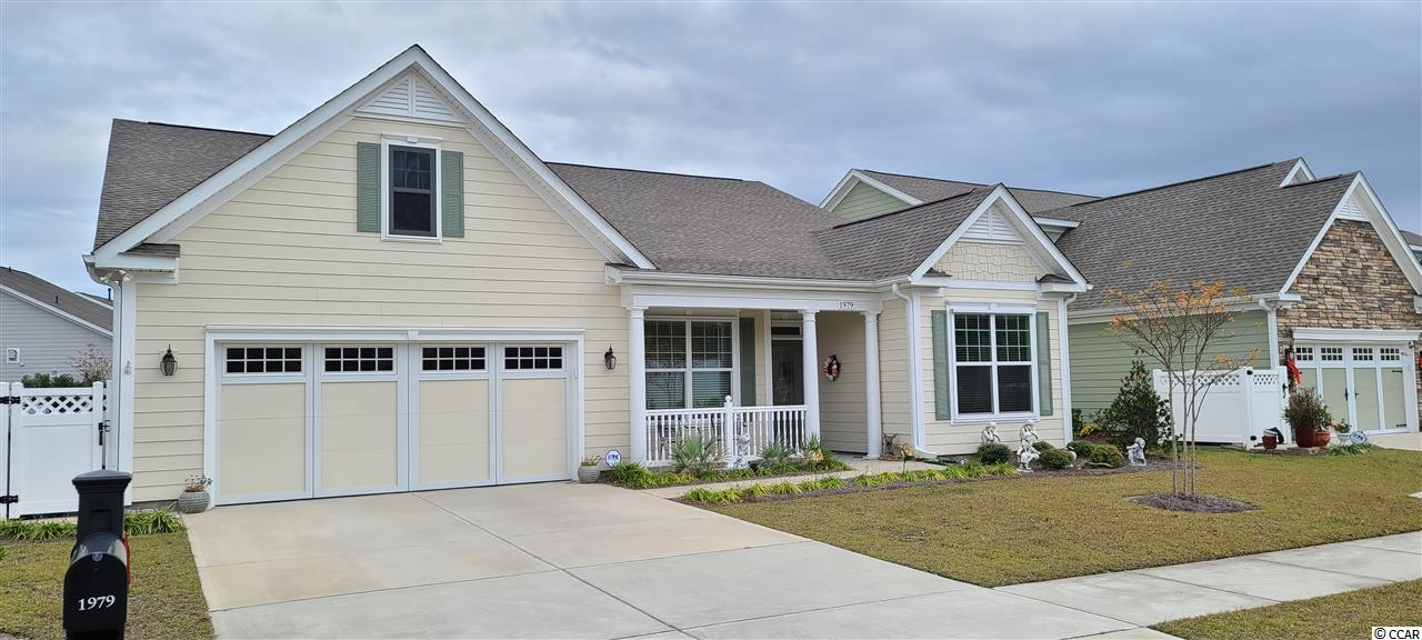This better than new, move in ready three-bedroom two and a half bath home has it all, plus Location, Location, Location.  Located in the Market Commons district of Myrtle Beach, in the highly desirable Cresswind Active Community, this home is nestled lakefront directly across from the stunning community Clubhouse and Amenities Center.  This two-year-old home has many upgrades, including, high ceilings, crown molding, engineered hardwood floors in all the bedrooms and tile throughout the rest of the home.  As you enter the from the front porch, you will find a formal living/sitting room that could also be a great home office or guest bedroom.  The two-guest bedrooms, with shared connecting bath, are located in the front of the home with this split bedroom floor plan.  The heart of your new home features the formal dining room, kitchen, and great room. Your kitchen features a butler's pantry and dining area, plus a granite island overlooking the great room.  Off the back, enjoy views of the water from your screened and vinyl window enclosed all season patio that is wired for cable.  Your master suite has tray ceilings, and a master bath with walk-in shower and an impressive walk-in closet.  The laundry room and half bath are located just before you enter the two-car garage.  This natural gas home has gas heat and hot water heater.  Enjoy the care free lifestyle of an active community with the resort like amenities of Cresswind located just across the street.  The 12,500 square-foot amenities center is filled with numerous facilities to stay physically fit and socially active.  There are two multi-purpose rooms, perfect for a holiday party or to host a club meeting, a demonstration kitchen, computer room, and a fabulous fitness center equipped with modern cardio and weight-training machines. There is also an aerobics and dance studio for those looking for a Yoga class.  The clubhouse also features an outdoor pool, pickleball, tennis courts, bocce ball, walking paths, 