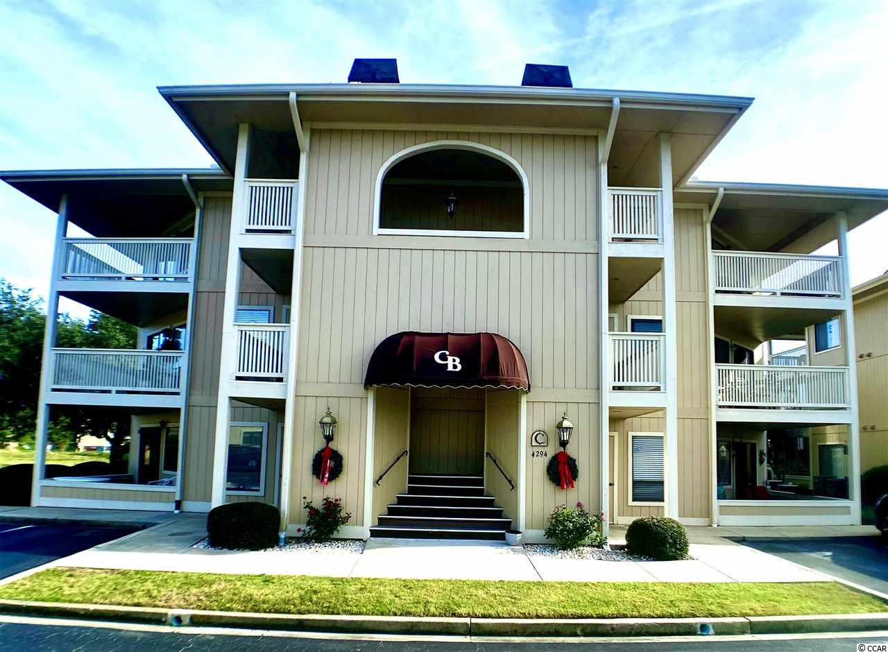 Fabulous FIRST FLOOR Condo in the heart of Little River.  This one bedroom one bath unit is located in Cypress Bay Community which offers two outdoor pools, a hot tub and a tennis court. This unit has never been rented and the owner has remodeled and upgraded many things. All wood floors in living and bedroom areas with tile in the kitchen and bathroom.  Over-sized 1 year old stackable washer and dryer. New hot water heater 2019. Enclosed screened patio for more living space with new large storm windows. Beautiful new sliding glass doors. Remodeled entire bathroom and put in new stainless appliances. Building C is located in the entry of neighborhood with a view of a small lake/pond off back enclosed porch area. Extra storage outside in enclosed hallway. All measurements and square footage are approximate and not guaranteed. Buyer is responsible for verification.