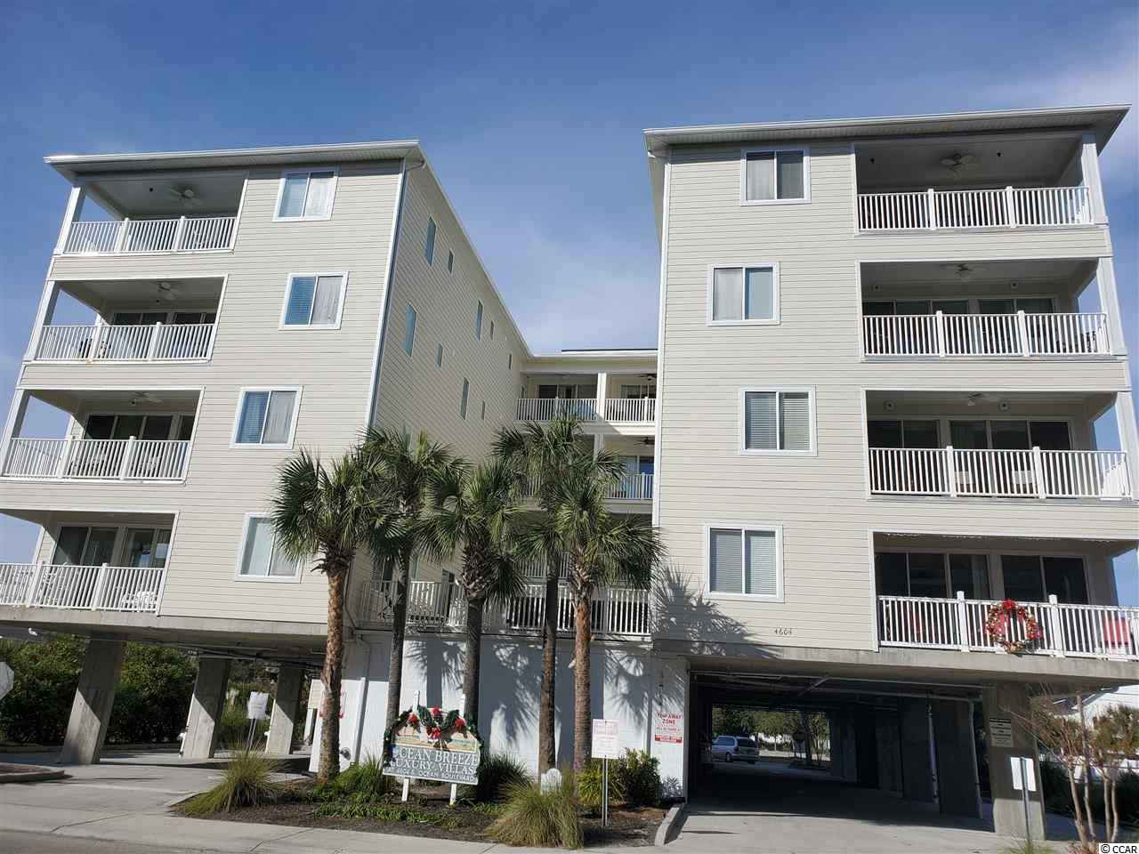 Watch the beautiful sunrise from your balcony in this large  4 bed, 4 and 1/2 Bath located in the Windy Hill section of Ocean Blvd.  Lots of entertaining for a large group with seating in the kitchen/dining combo for 18! Kitchen is fully furnished with stainless appliances and an extra large refrigerator/freezer.  There is a second balcony off dining and a bedroom overlooking the pool besides the large one with the beach view! Living room adjoins an extra large game room with a wet/bar and beverage frig. The Master has a large walk in closet and the bath has dual sinks and jacuzzi tub. Each bedroom has its own bathroom and the powder room in the hall for guests. Beach access is just across the street. Located minutes away from Barefoot Landing, restaurants, shopping and golf! Would make a great vacation home, investment property or full time residence.  All measurements are approximate and to be verified by buyer.