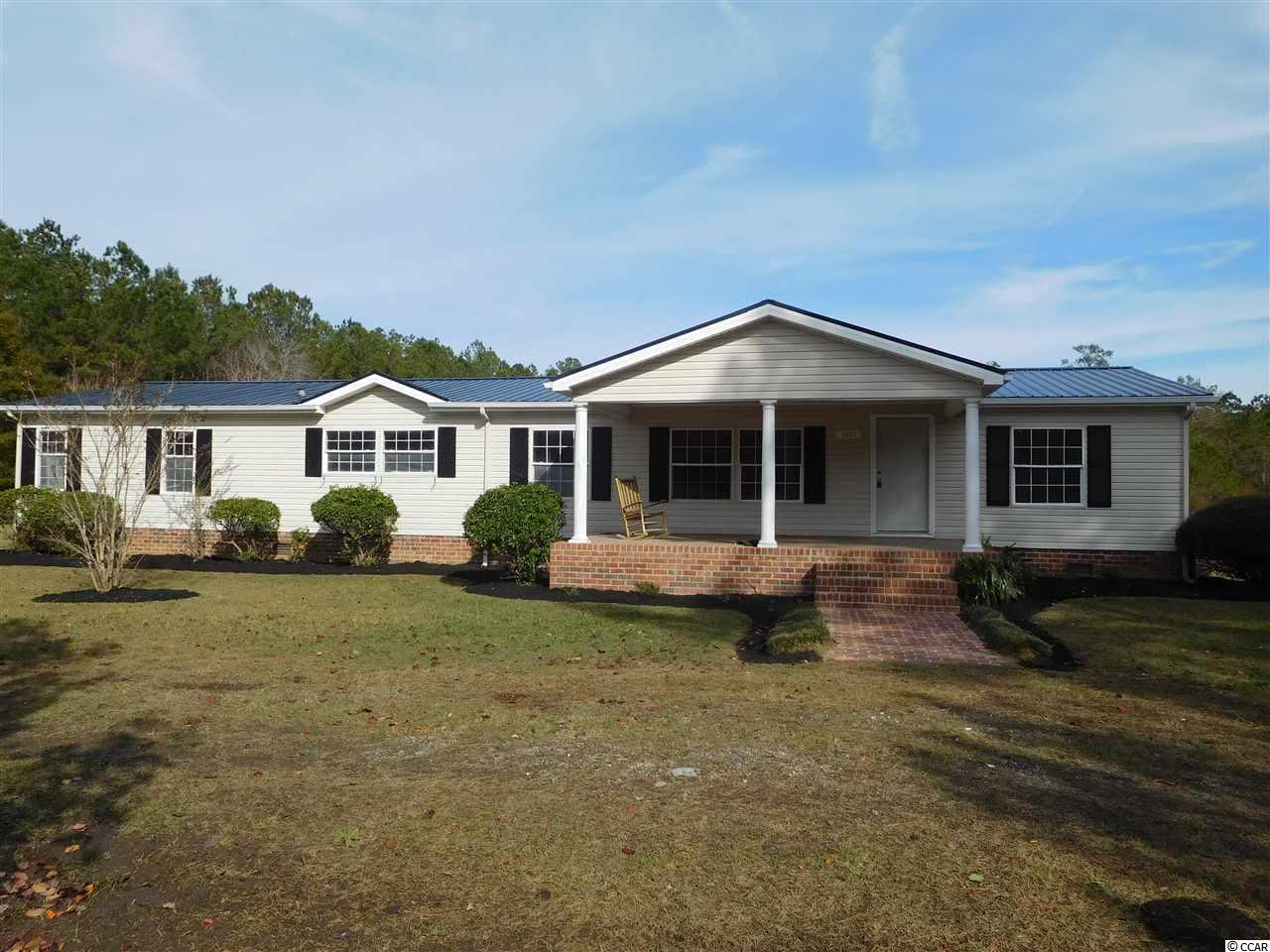 This is a very special property that must be seen to truly appreciate. It features over 6 acres and sits on a beautiful private lake. Enjoy all of this, being away from it all and  just 10 minutes to Cherry Grove Beach . Completely updated throughout. There are  5 bedrooms, one of which is a nursery attached to the master suite. It offers 3 full baths and a separate laundry room. The updates include granite countertops, stainless appliances in the kitchen, new flooring throughout, soaker tub in master bath along with separate tile shower . ALSO New metal roof ,NEW  windows, NEW  water heater    and  NEW AC unit just installed.  Large storage shed on property.  Single wide trailer  on property which needs remodel.       All measurements are not guaranteed, buyer is responsible to confirm accuracy. A Licensed Realtor has an ownership stake in this property.