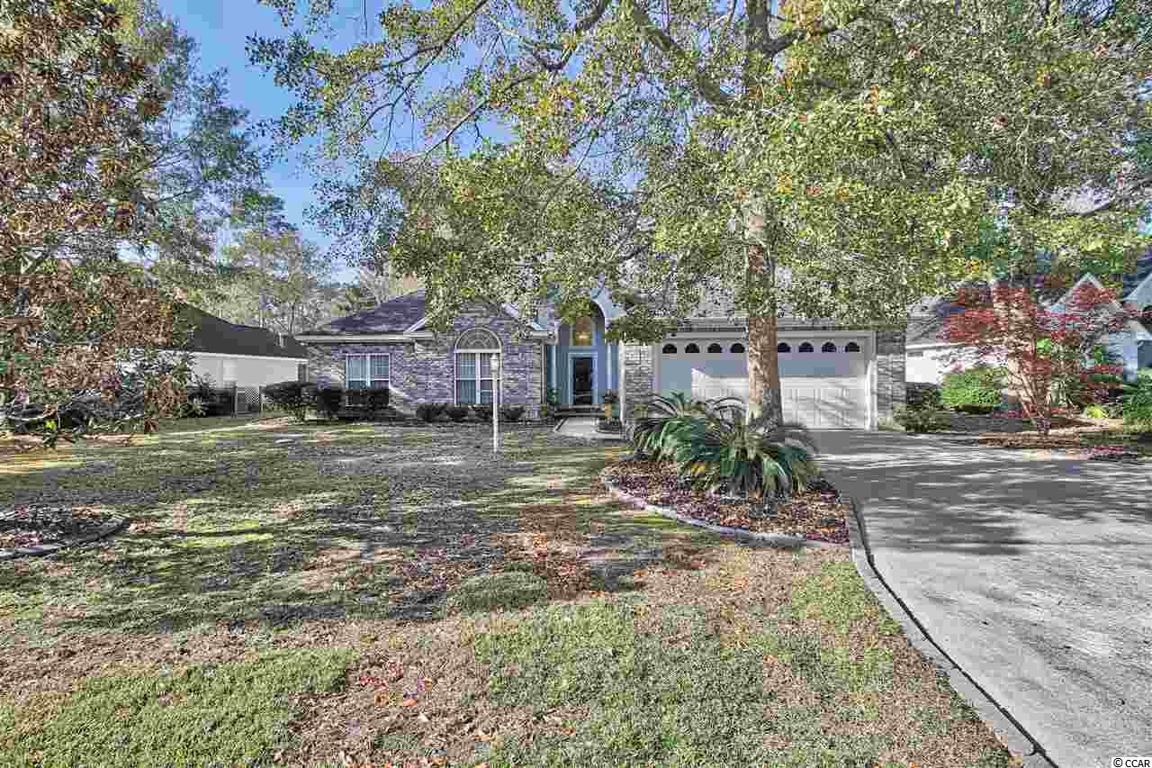 This custom build home in Indigo Creek golf community has great curb appeal.  It has too many unique features to mention all of them.  When you enter the open 2 story foyer you are shrouded with lots of light and beautiful hardwood floors.  To your immediate left, there are two bedrooms and a full bath on the front of the house.  Enjoy the build ins as you travel down the hallway.  This home hosts a huge kitchen with triple sinks, wet bar, appliance barn, work island, built in desk, eat in breakfast nook and gas range.  The white custom cabinets have lots of upgrades like glass doors and range hood.  The all white countertops make it airy and bright.  Off the kitchen is a large walk in pantry and laundry area with stackable washer/dryer,  which also work off gas,and laundry sink.  The living room has beautiful, 18' vaulted ceilings and double sided fireplace which it shares with the dining room that could easily sit 10 or more.  Off the living room is a Carolina room with French doors and transoms to let more light into the living room.  There is also a four seasons porch to enjoy the outdoors almost year round.  The master bedroom has tray ceiling and the master bath is conveniently situated to accommodate both of you at the same time.  There is a separate Jacuzzi tub, shower, dual vanities with lots of storage, a linen closet and nice size walk in master closet.  You will find more storage, which is floored, in the attic over the garage.  There is a patio off the kitchen where you can hook up your gas grill (line provided) and enjoy cooking outdoors.  The roof was replaced 2013, HVAC replaced 2016-2017 with 10 year warranty, hot water heater replaced 2012, buried propane tank that is leased.  Lexan provided for special custom windows and Hurricane shutters for the others. The home sits on the 13th hole of the golf course but mature trees provide plenty of privacy.