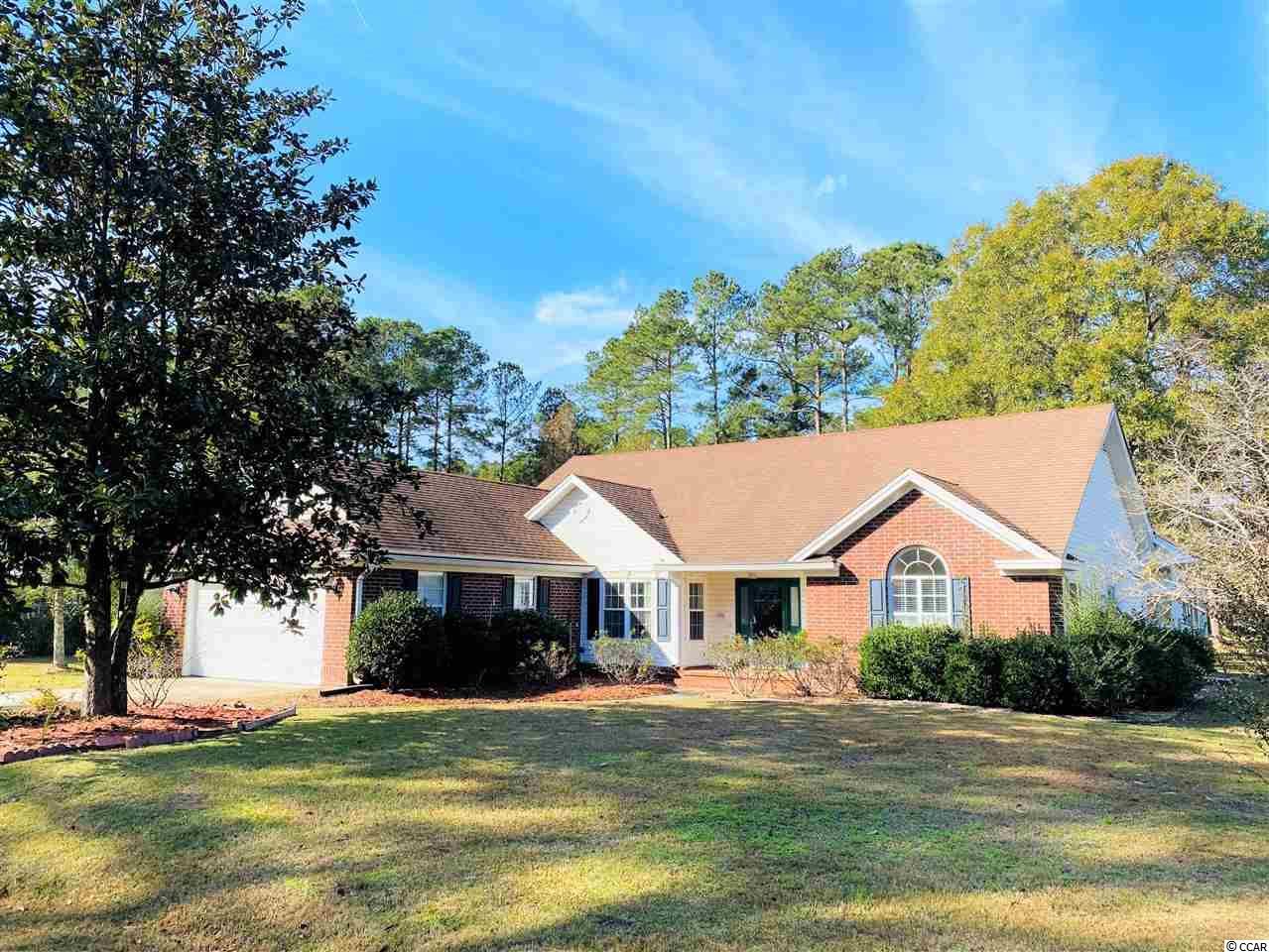 194 King George - Very nice brick ranch style home in Wedgefield Plantation, located in coastal Georgetown, South Carolina - one level easy living!  Split bedroom floor plan with three bedrooms and two baths.  Very bright and open space with room for entertaining inside and out. Vaulted ceilings in great room, separate formal dining room, kitchen with breakfast bar and nook, sun room and all season room over looking the large back yard and Wedgefield Golf Course. Owner's suite with vaulted ceilings, bath with walk-in shower, garden tub, and double vanity.  The other two bedrooms are spacious with a shared bath in between. Additionally, there is a two car garage and a detached storage building.  Wedgefield Plantation is an active and beautiful community with it's own public golf course and a boat landing into the Black River.  Enjoy wonderful dining onsite at The Manor House, an easy golf cart ride away.  Separate memberships available if you so wish - pool, social and golf. Close to historic Georgetown waterfront Harbor Walk, shopping, wonderful restaurants, fresh seafood vendors, and access to five rivers that surround the area with an easy drive to Pawleys Island, the closest public beach access.  *Buyer responsible for verifying square footage.