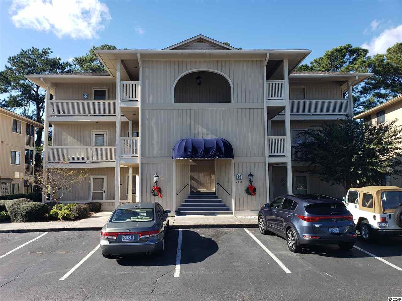 FOUND - The Needle in the Haystack! - a desirable top floor 2 bedroom & 2 bath, end unit. This fully furnished condo with a pond view is located in the desirable community of Cypress Bay, Little River. Entering your condo, you'll notice the newly laid luxury vinyl plank flooring that extends throughout every room. Easy care and waterproof too! The kitchen shines with freshly painted cupboards and all appliances convey. The breakfast bar adds seating for relaxed eating.  The dining area is open to the living room, has a ceiling fan, and its high vaulted ceiling adds volume. This relaxing living area opens to the screen-in porch which offers a view of green trees, the pond and fountain - peaceful & serene. The master bedroom (faces the pond) and has an attached bath. You have access from the Master to the screen porch, envision sipping your morning coffee here – start your day with tranquility. The Guest bedroom is at the other end of the hallway plus the guest bath. There is a convenient laundry room with washer and dryer and a pantry/storage closet. Catch some rays at the community pool and hot tub/spa. You're just minutes from all the amenities offered by this coastal region: retail & consignment shopping – shop 'til you drop; a myriad of restaurants whose offerings will please any palate; tee off on one of the 65+ championship golf courses within a 25mile radius; cruise thru art galleries, join a class - painting, jewelry making or pottery. Kayak in the ocean & rivers. Catch your limit on a deep-water fishing charter or from a pier. Try your hand at flounder gigging.  Embrace lady luck on a moon lite floating casino cruise. Stop by Patios in Little River for a drink & listen to live music under the stars. Love the beach? You're just a sip of lemonade & a few short minutes to the sugar white sands of pristine serene Sunset Beach, NC and to the beaches of SC.  Ideally located between Wilmington 1hour N & N Myrtle Beach SC 5 min S.