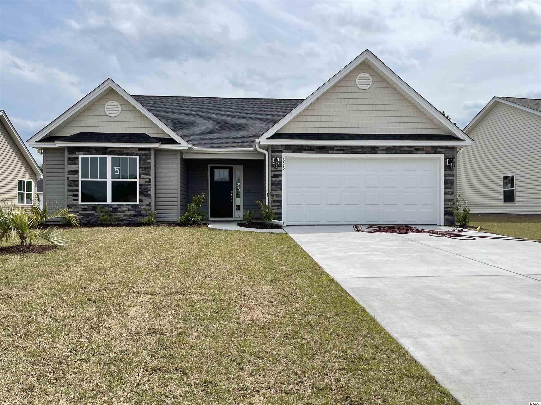 Red Hill commons is a new community located in Conway area only a few miles from the Beach and major shopping! This is the Princess floor plan with added expansion through center. Open floor plan on a 0.18 ac home site featuring 3 bedrooms, 2 baths. this home includes a finished 2 car garage with garage openers. Ceramic tile in all bathrooms and Laundry room, Granite Kitchen Countertops, crown molding on kitchen cabinets with hardware included. Vaulted ceiling in Family room, every bedroom. Home also includes TAEXX pest control tubing!! Stone accents on the exterior as well. All measurements are approximate  Estimated completion time May 2021