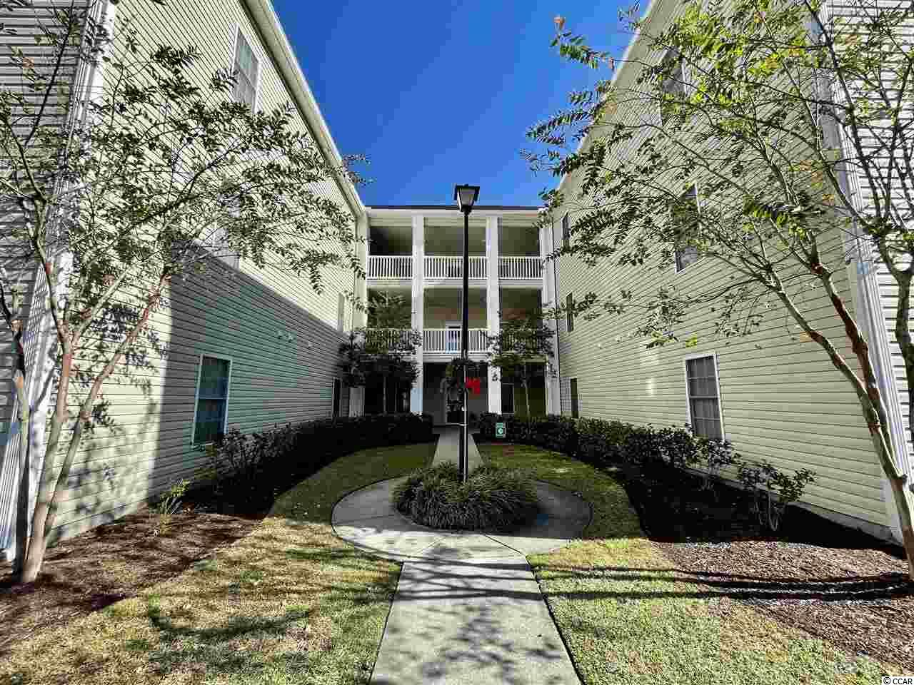 This is a bright and airy 2 bedroom condo located on the edge of Surfside Beach and Myrtle Beach. This floorplan has a nice flow as you enter through the foyer and drawn the screened balcony past the living room. A new hvac and refrigerator were installed last year. This spacious end unit condo comes completely furnished. Either a short stroll to the pool that over looks pond or a 2.5 mile drive to the ocean makes it a perfect way to spend your day. Also near by is Market Commons which hosts some of the best boutique shopping and dinning in our area.