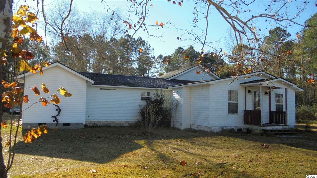 Wonderful country setting yet an easy drive to Hwy 22, the beaches, river front in Conway and shopping. Spacious and affordable living can be enjoyed in this 2 bedroom 1 bath home. Originally built in 1973 as a manufactured home however has been added on to over the years with an effective date of 1995.. Title is retired. Unable to obtain any info on original manufactured home. Property offers a large work shop with parking. The upstairs is open ready to be finished in the shop. Great possibilities here. Great road frontage. 2 sep. electric meters. 2 septic tanks for the home and has an additional tank on the property where an RV/trailer once sat. has potential but needs work. Call for details.