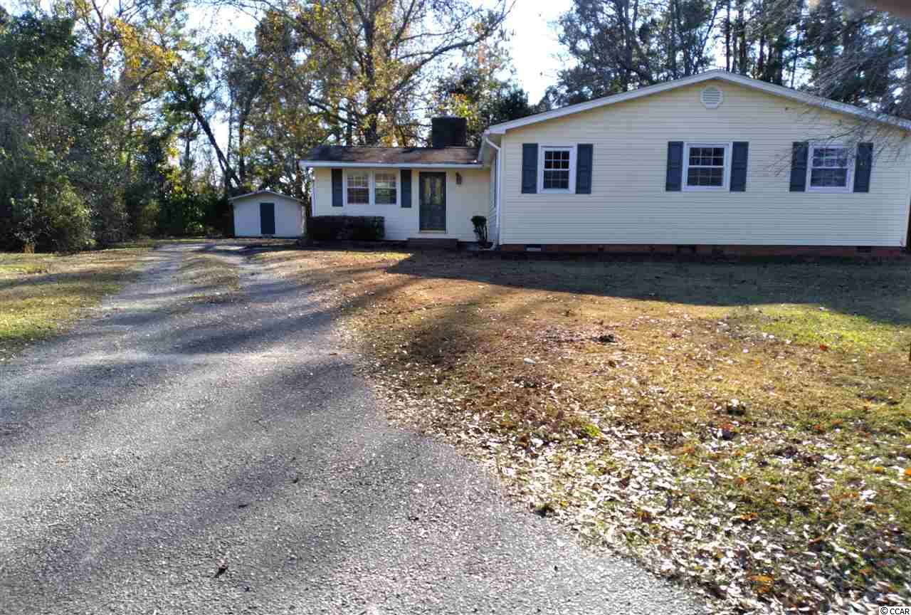 """*NEW ROOF FEBRUARY 2021!* One-story home located in the old historic district of Conway. Situated on .40 acres, the home originally built in 1955 was renovated in the mid 1970s and has over 1670 SF of heated space. Large back yard with partial fencing. Huge back deck. The home features 3 bedrooms and 2 baths. In addition there is a combined living and dining area with wood burning brick fireplace, kitchen and a large utility area. Home needs Rehab Construction but has good potential. Home being sold """"AS IS"""". Home is not in a high risk flood zone."""