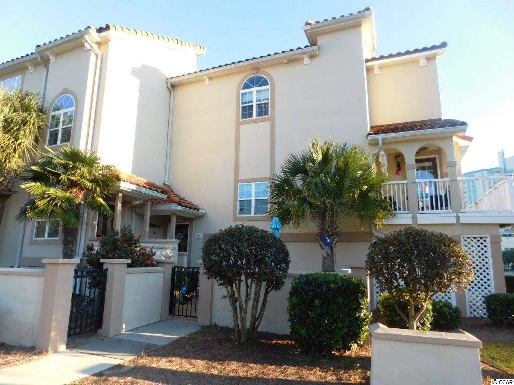 """This is a gorgeous, upscale and """"upgraded"""" 3-bedroom, 3.5-bath, 2-car garage, in the Mediterranean style, end-unit townhome that is just one block from the ocean in the Ocean Drive area of North Myrtle Beach. Coakley Baye is a very desired complex of only 11 units, located in the Tilghman area of North Myrtle Beach, one block from ocean, area attractions and close to Main Street to offer you close proximity to fantastic restaurants, shopping and shagging. Drive up to Coakley Baye and feel the difference. This large end unit is spectacular and boasts a 3 stop private elevator to all 3 levels of the home. One of the largest and most upgraded units in the complex – not to mention absolutely beautiful inside and outside. From the main level, enjoy an open, expansive, light atmosphere which is accented by lovely windows and doors and a wraparound deck on front and side for enjoying, listening to the ocean and cool breezes and a covered porch on the front of home for enjoying the peace and quiet of outside living space. Main area features a huge, open family room, 3 steps up to a magnificent new kitchen and dining area boasting lovely new wood plank LVT flooring, open wire railing to define dining area, yet adds beauty and openness to your new space. Some recent upgrades to include but not limited to are: new flooring in first and second floor, backsplash in kitchen, new island and cabinets, quartz counter tops, upgraded Kitchen Aid appliances (with an induction stove top range), French door refrigerator, microwave and quiet dishwasher. All new HVAC (2016) with 3 zone controller, garbage disposal, new courtyard pavers and inside all stairs replaced with solid oak floorboards (2018), and new light fixtures throughout the home. There are just too many upgrades to mention them all, but this home will please even the most discerning buyers. The main level has access to outside decks/covered porch, half bath, elevator and kitchen, for convenience for both owner and guests. The"""