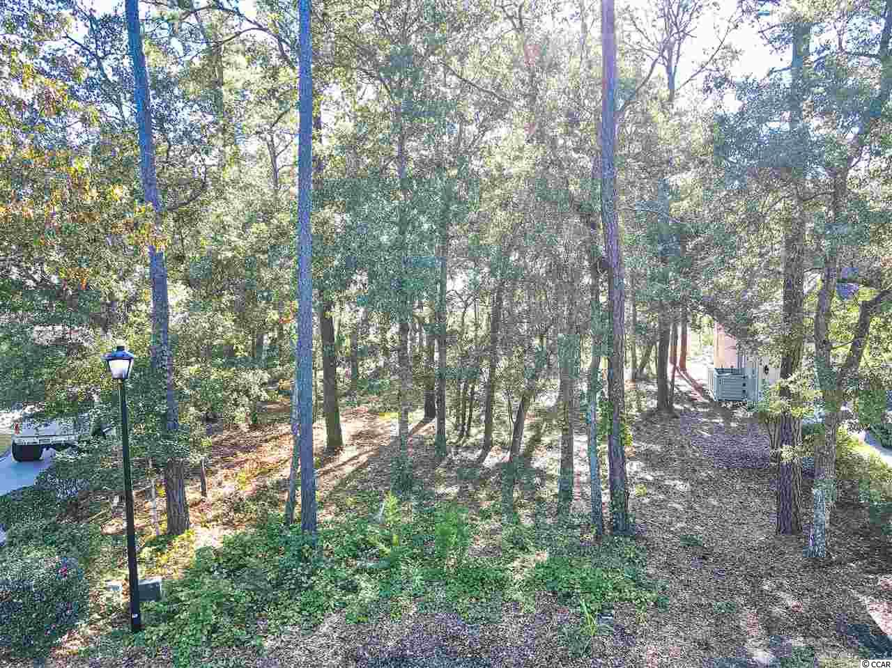 Elevated lot with beautiful marsh views of the Cherry Grove marsh, and inlet on the south end of the Bluffs section in Tidewater Golf Plantation gated community with 24 hour security. Deck is allowed. Lots of amenities, many pools, pickle ball, tennis courts, bocce ball court, oceanfront cabana, fitness center. All that you can ask for.