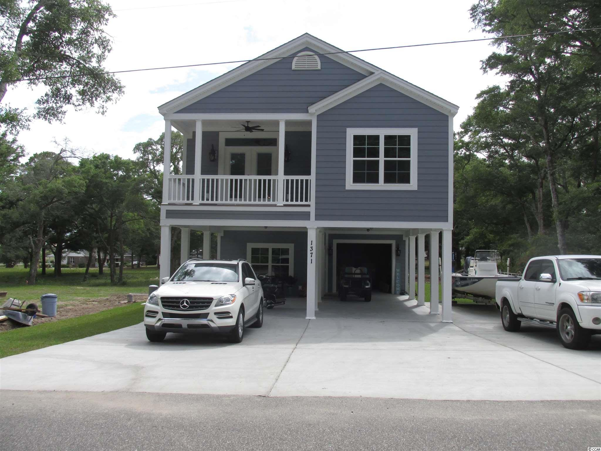 """A diamond in the rough! This area of the beach has some of the best views anywhere. Overlooks Hog Inlet in Cherry Grove and ocean views. Home features 3 bedrooms upstairs with an open floor plan and 2 full baths. Lots of upgrades! Kitchen offers granite countertops & stainless steel appliances. Vaulted ceilings, 5 1/4 base throughout, 3 1/4 casing on all windows and doors, wood floors, breakfast bar, ceiling fans in all bedrooms, granite countertops in kitchen and bathrooms, French doors, elevator shaft and buyer can add elevator at cost. The downstairs has 1 full bath with a large open room for entertaining or """"man cave"""" with an additional room for storage, office space, or could be 4th bedroom. This area is heated and cooled for easy conversion. Plenty of parking underneath house. Pictures are of another home already built at another location. Picture represents a model home. NO HOA's!"""