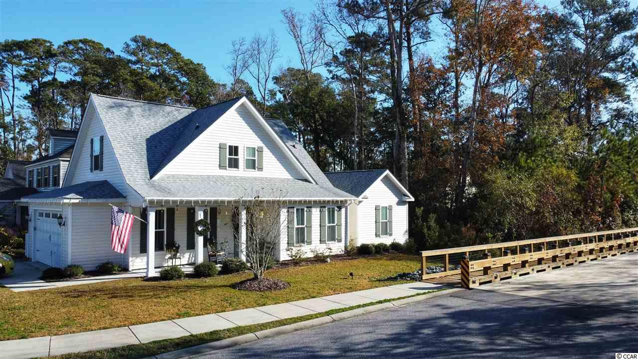 "Located in The Bridges of Litchfield, this conveniently located neighborhood puts you in the heart of Pawleys Island.  The beach is just minutes away, Healthpoint Fitness Center is within walking distance & Stables Park Tennis Center is even closer.  Built in 2017, this home has been meticulously maintained.  The first level offers an open, airy floor plan.  The master bedroom is conveniently located on the first floor along with a half bath for guests.  The luxurious kitchen boasts granite countertops, custom-tiled backsplash, and stainless steel appliances.   The living room and kitchen flow into a combined space that is great for entertaining.  The additional two bedrooms and full bath are located on the 2nd floor.  The exterior has a ""rocking chair"" ready front, rear patio & artificial turf backyard.  This turf is maintenance free and great for pets.  The entire backyard is fenced.  16 Dunning Road  awaits its next owner!"