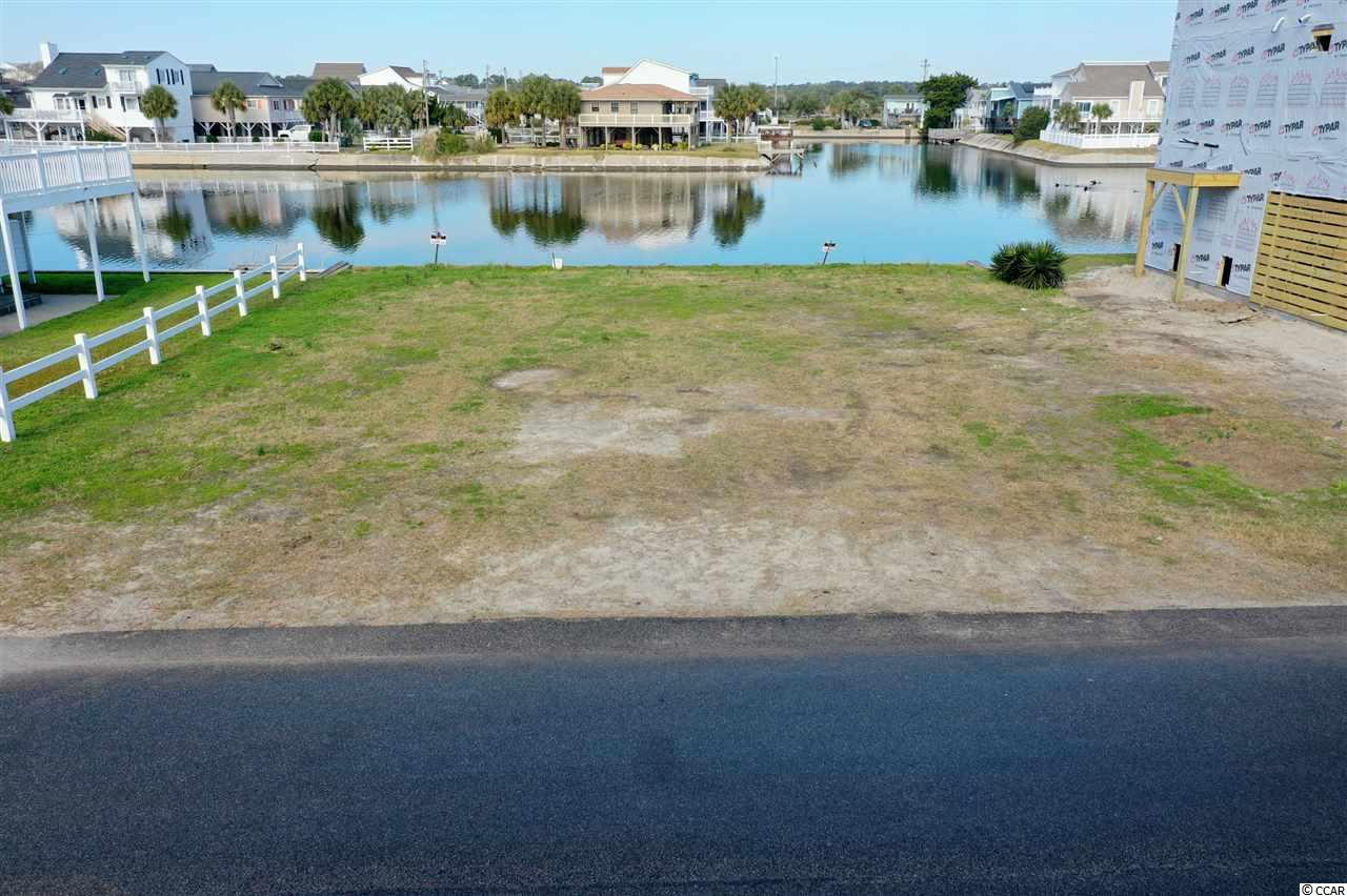 Residential lot only 300ft to the beach and sitting on a private lake. Lake is suited for paddleboarding, kayaking and canoeing! An exceptional location for building your very own lake front beach home! Very few lots become available at Cherry Grove Beach, especially on the lake! Golf cart to everywhere in Cherry Grove and North Myrtle Beach! If you appreciate the finer things in life, then build your dream on this magnificent water front propety.