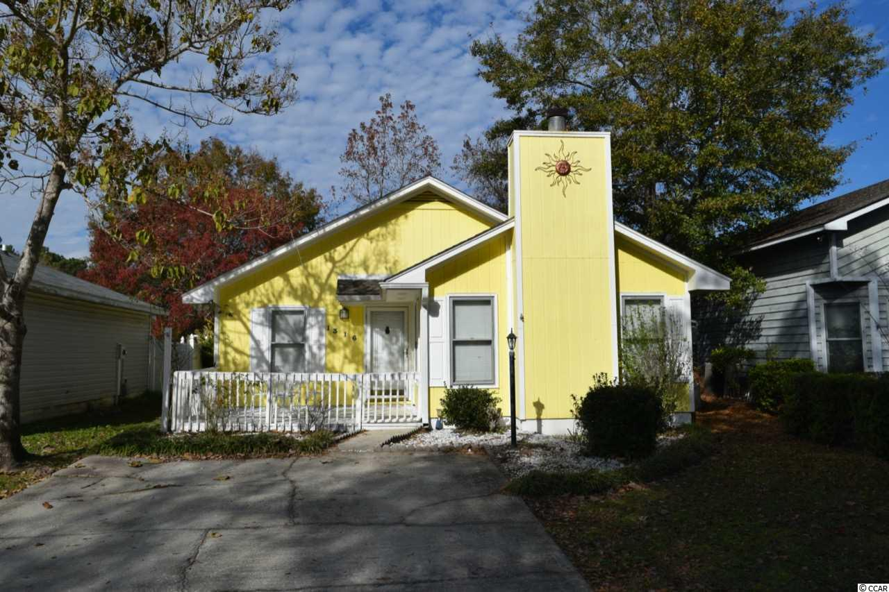 Welcome home to this well loved 2 bed 2 full bath. Nestled in the heart of Myrtle Beach, location is everything. With no HOA, this is a rare opportunity for a primary or investment property. With newer appliances, a wood burning fireplace with beautiful brick and peaceful porches; pack your bags and enjoy.