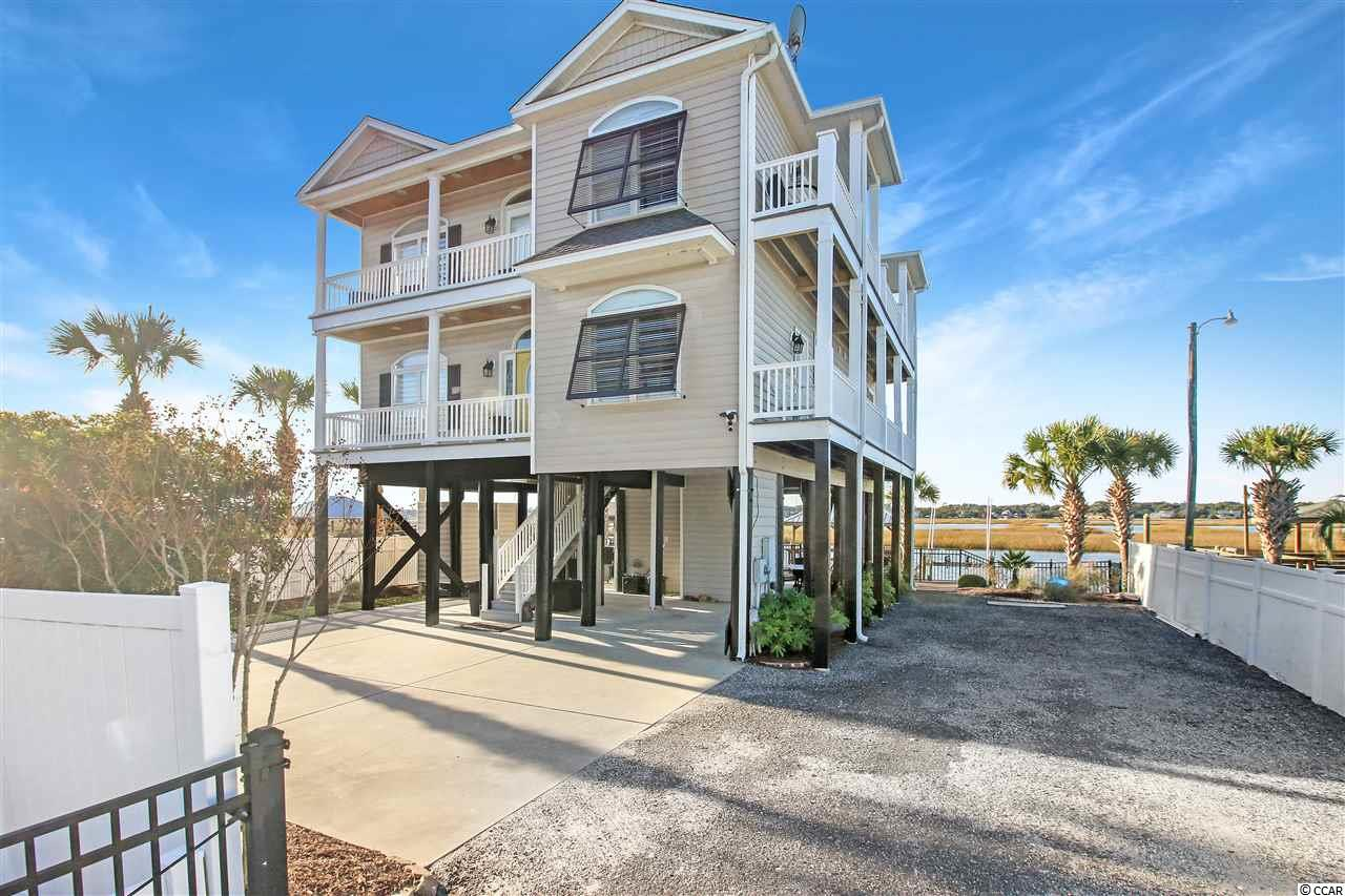 Welcome to one of the finest Creek homes in all of Garden City Beach. This 5 bedroom home has 4 full baths and 2 half baths, one of which is on the ground floor! For the boating enthusiast, there is a stationary dock, a floating dock, a jet dock, as well as a boat lift. The depth at low tide was measured this week and there is over 3 ft of water at low tide giving you access to Murrells Inlet at all tides! Inside on the main level is a state of the art kitchen, dining area, living room, and balcony, all with expansive views of the inlet. There is also one of the two master bedrooms which has great Northern views up the creek as well as a wonderful ocean view. Upstairs you will find the additional four bedrooms and 3 baths. Every single room has a great view. On the ground level, the home is set up to entertain. There is a lovely sitting area by the huge hot tub to take in those great Murrells Inlet sunsets. There is also a nice dining area to have fellowship with friends and family creating the kinds of memories that last forever. If you have had enough of the creek and want to venture out to the ocean, you're just a short walk across the street with a beach access right at the end of your driveway giving you the best of both worlds. While the home is mostly furnished, there are some items that will not convey with the sale.