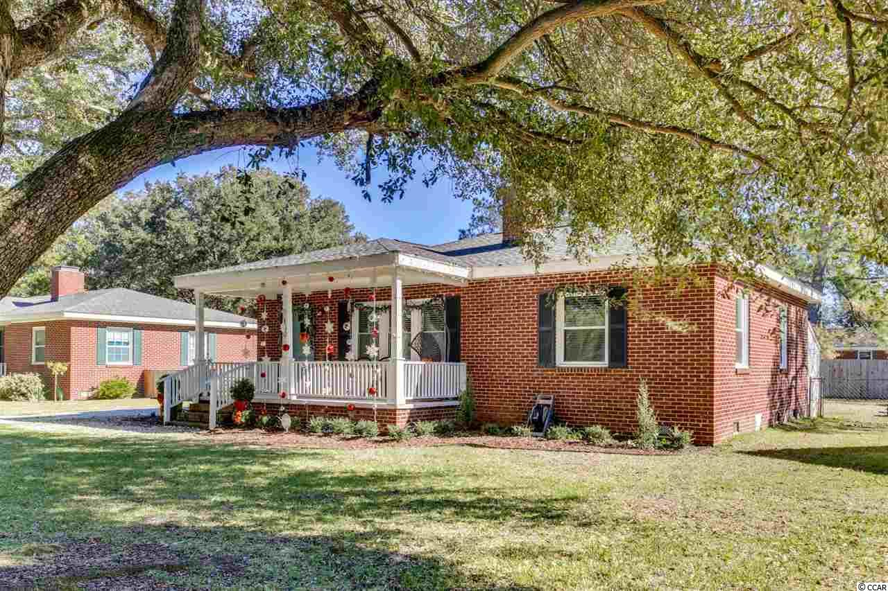 Completely updated ALL brick home in the desirable Kensington Estates community.  Low country front porch, fireplace and upgraded flooring- no carpet!  Updates include, New washer and dryer and newer range and dishwasher as well.  The bathroom is gorgeous! Double sinks, newer flooring and unique vanity, Home was renovated with New Roof and HVAC, and Windows as well as updated electrical and plumbing and completely incapsulated all in 2018.  Termite bond is transferrable.   Lush Landscaping and a huge garage that fits both the car and has a ton of room for storage it also has a newer garage door opener!  Property has a nice size yard and it also has a well for garden and outside watering needs and the Raised garden beds may convey or be removed.  Fantastic opportunity to own your own home at a great price!