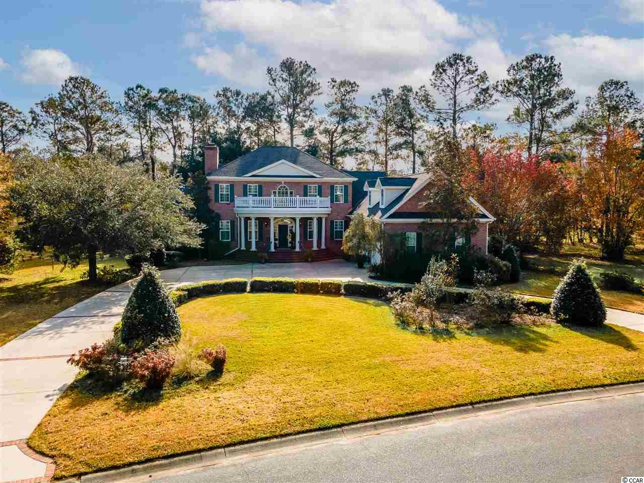 OPEN HOUSE SUNDAY JANUARY 10TH 1-4. Stay on Willbrook Drive until the gate with the guard.  This all brick, Low Country home, has the feeling of a classy elegance, located in one of the most desired neighborhoods in all of the Grand Strand, Willbrook Plantation.  Located in beautiful Pawleys Island, where you find  Spanish Moss draped from the Elder Oaks, you have the feeling of peace and serenity in this amazing community. This home features 5 bedrooms with the Master on the first floor, 4 full bathrooms that allow family and guests full privacy, and two half baths for those days of entertaining. A custom kitchen with a flowing floor plan that leads to a breakfast area with stunning amounts of light. A beautiful family room with a cozy fireplace centers this home, and leads to an all brick back porch that features mature Oaks and views of the famous Willbrook Golf Course. A private sitting area with it's own wood burning fireplace is a perfect place for a peaceful evening.  The roof was replaced in 2019, three HVAC systems, a crawl space New Dehumidifier, and two guard gates for added security.  The community has Beach access to Litchfield by the Sea that is accessible via golf cart or by car and a wonderful resident only clubhouse with a private community pool.  This should be on your list for your forever home.
