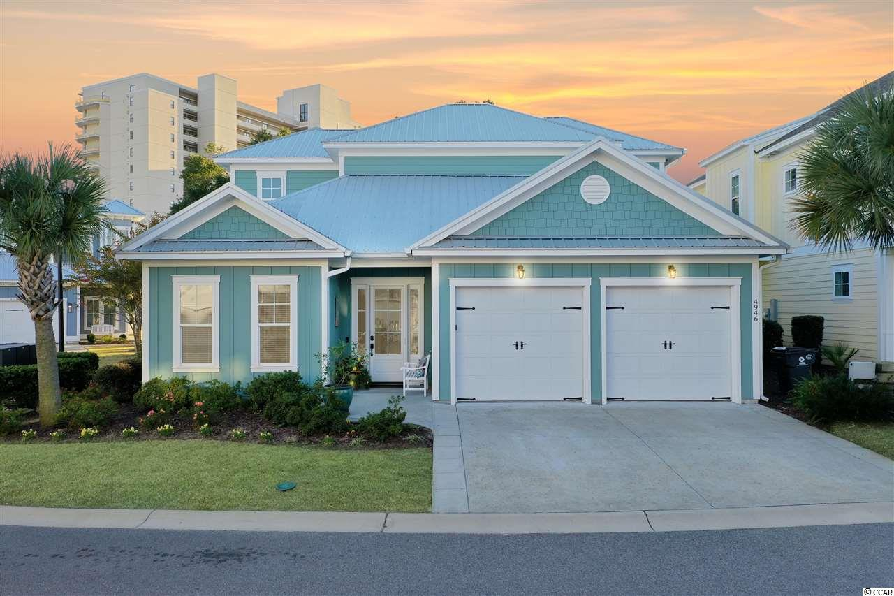 This NEVER RENTED custom built 2-story home located in the Whitepoint neighborhood of North Beach Plantation features 4 BR/4 BA & 2-car garage, private backyard with large nature area, heated pool with multi-colored lights & covered pool area with view of the ocean and swash from a custom articulating aluminum louvered pergola with gutters, phantom screen on rear of home to backyard, side privacy screen, outdoor kitchen, outdoor shower with hot/cold water, 2 gas firepits & outdoor speakers to enjoy this backyard oasis with great ocean breezes.  Hardwood flooring throughout, coffered ceiling in Great Room, tray ceiling in Dining area, Kitchen has SS appliances, cabinets to ceiling, granite countertops, custom shelves in pantry, industrial garbage disposal & under cabinet lighting.  1st Floor Master Suite with tray ceiling and deluxe Master Bath with claw foot tub & frameless shower.  1st floor Guest Bedroom with ensuite bath, 2 upstairs Guest Bedrooms with private balconies & ensuite baths; dual water heaters, large storage closet with custom shelving on 2nd floor and pull down attic storage.  Retractable screen door on front door with Schlage keyless entry, Ring doorbell, 4 security cameras - 2 inside, 2 outside (front & back of home).  This is a one-of-a-kind floor plan in North Beach.  Home has handicap accessible entrance and handicap doors. North Beach Plantation is a 60-acre oceanfront destination resort that features a 2.5-acre pool area with a swim-up bar rated#1 in the US by TripAdvisor, 8 pools, 5 hot tubs, lazy river, world-class spa, Beach Fit fitness center, shuttle, security and 3 on-site restaurants located across from Barefoot Landing.