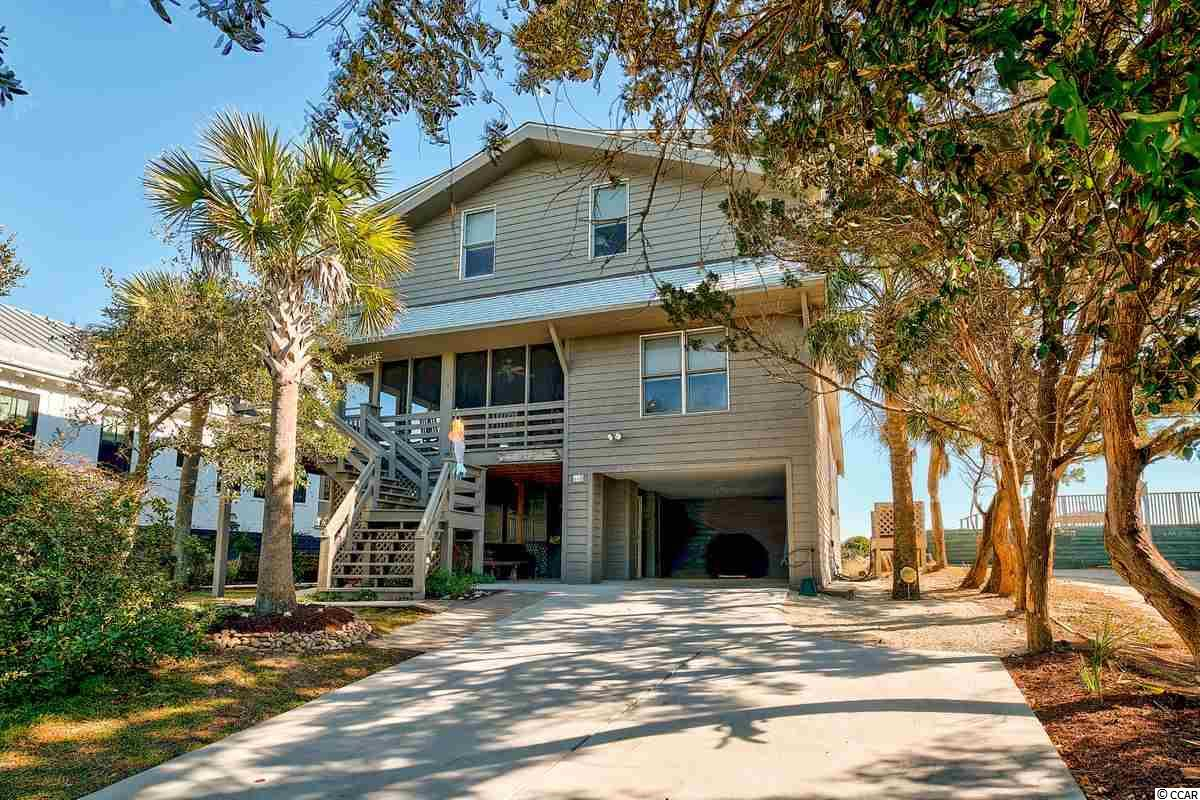 This Pawleys Island beach house is located in the southern center of the island. The beach is wide, and unfrequented by the general public in this area. The 8 bedrooms and 8 bathrooms as well as the ample parking provide plenty of rooms for friends and family to make long lasting memories at the beach.  Enjoy the ocean breeze from multiple porches, the sunning deck or the widow's walk.  Outdoor lighting creates an inviting ambiance for late evening story telling and reminiscing. Downstairs provides a large bonus room, plenty of storage, and his & her baths and showers for returning from the beach. The main level has wonderful front and back porches, a living room, kitchen, and two master bedrooms. Larger than most oceanfront Pawleys Island homes, 468 Myrtle is the ideal spot for large gatherings and family vacations.
