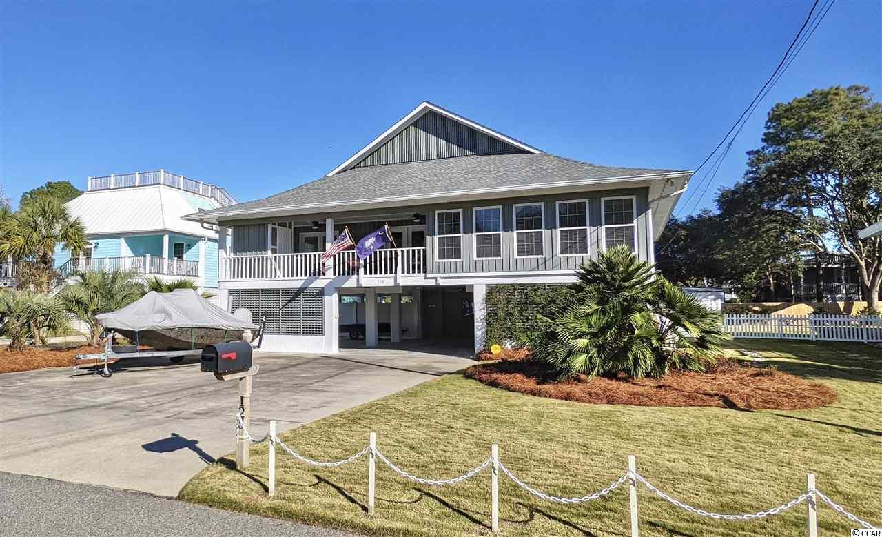 Beautiful, well-maintained 4 bedroom 4 and 1/2 bath raised beach house located in the much desired community of North Litchfield beach, just a short walk to the ocean! Home boasts large family room with cathedral ceilings, exposed beams, wet bar and massive fireplace. Spacious kitchen with breakfast area flows into an open dining area...perfect for entertaining. Rear deck, patio, and large front porch offer tons of outdoor living space as well. Professionally landscaped yard, new irrigation system, custom salt water pool, large storage area on ground floor, and new elevator are just a few of the great features of this property. Recent improvements include newly replaced roof, HVAC, HWH, windows, fencing, custom doors and window treatments, new karndean flooring, new carpeting, new exterior and interior paint and much more. Offered fully furnished, with the exception of a few personal belongings, complete with golf cart.