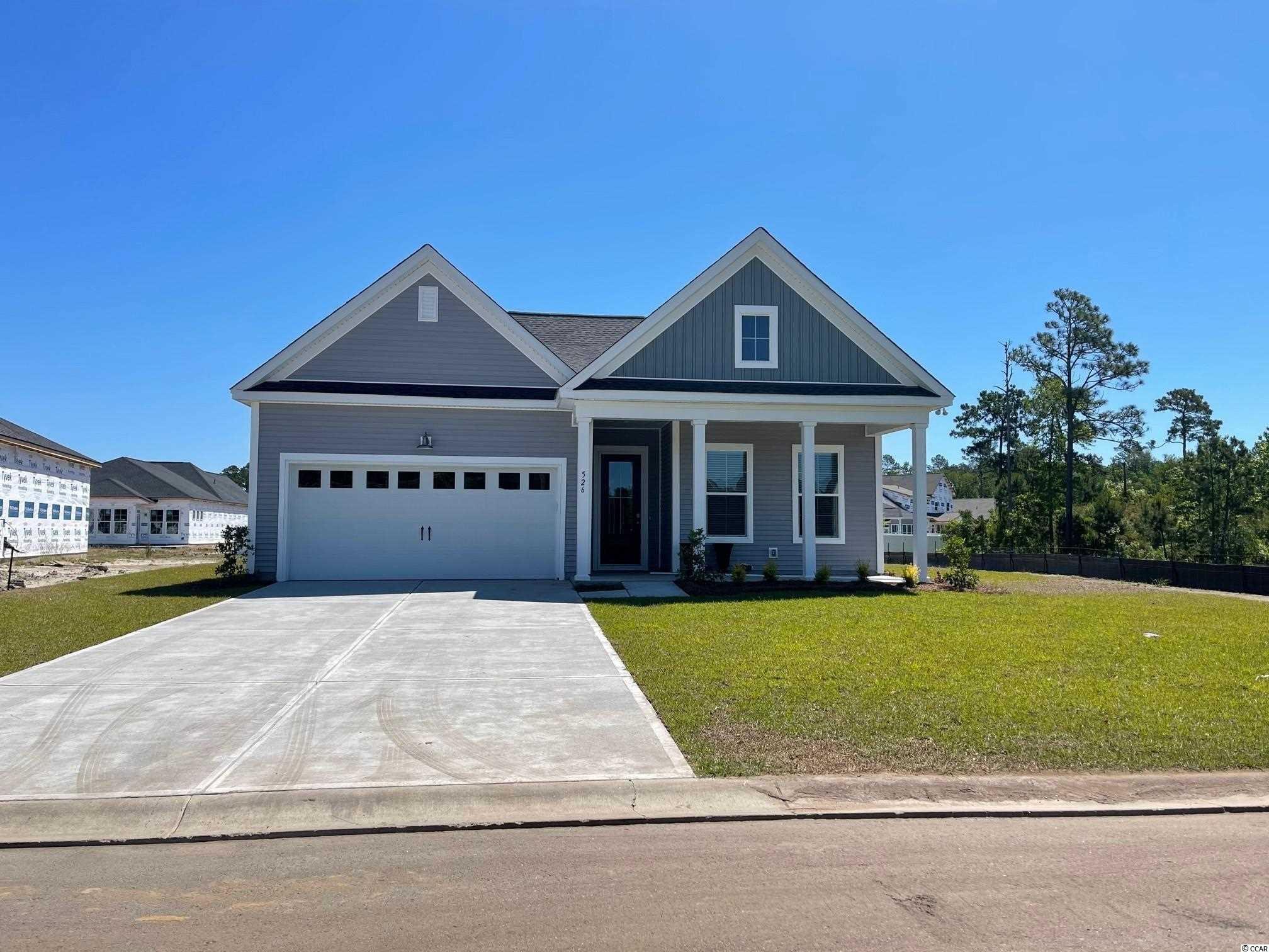 EXCITING NEW COMMUNITY! Wren Bay boasts over six acres of pristine ponds, 2.5 acres of wetlands, and 2.8 acres of green space. The resort style swimming pool will offer a sundeck, bath house, and outdoor gathering space. Easy access to everything you need right outside your door! We are just 5 miles from the crisp blue waters of the Atlantic Ocean, 3 miles to Marshwalk, and just minutes from retail and grocery shopping. The Madison Plan offers an open concept with soaring 10ft ceilings, gas range and upgraded kitchen, Hardwood flooring, Sunroom, double door entry into the Master, and double sinks. The garage is a wood workers dream with a tandem garage, that can be used as a workshop, golf cart bay, or extra storage! Home is under construction and will be ready Spring 2021.