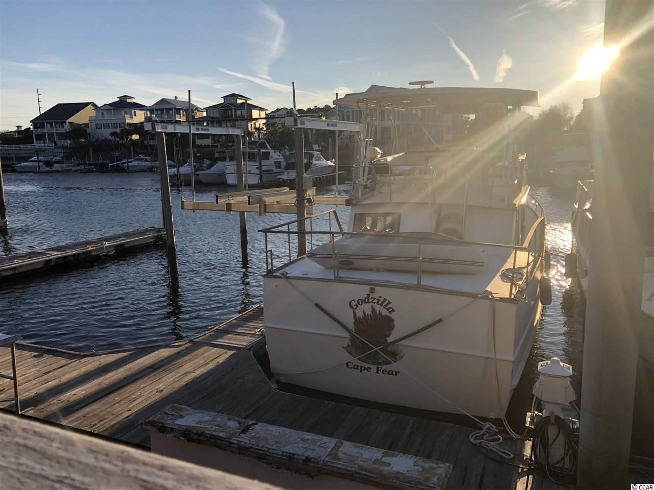 Great opportunity for a 40 ft. boat slip in the beautiful Dock Holidays Marina. The Marina is located directly on the Intracoastal Waterway at 13th Ave. North by Boardwalk Billy's restaurant, easy access to the ocean from the Little River Inlet and 1 mile away from the Cherry Grove Swing Bridge.  Owners are able to live aboard for an extra fee.  Low monthly HOA fee includes basic cable, water/sewer, trash and common dock maintenance. Awesome views!!!