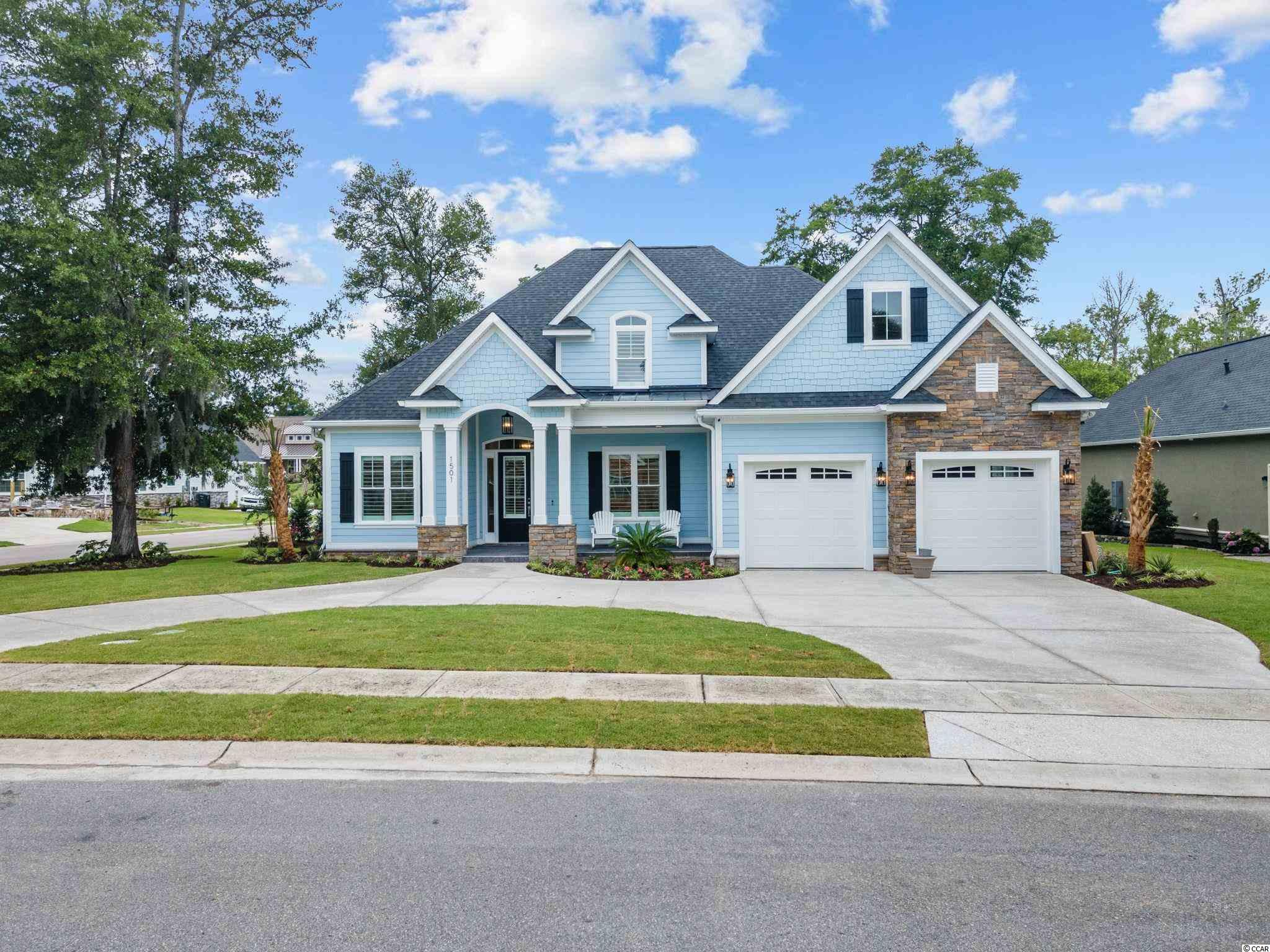 This beautiful custom built home is located in the prestigious Surf Estates neighborhood in North Myrtle Beach. 4 bedroom 2.5 baths, open floor plan, formal dining room, and huge bonus room! Master bedroom offer tray ceiling, 2 walk-in closets with custom shelves, garden tub, walk-in tile shower, double sinks with granite counter tops, and large linen closet! Enjoy natural gas for your kitchen range, additional ice maker, large kitchen island, walk-in pantry with custom shelves, granite counter tops, tile backslash and breakfast nook. The living room offer a gas fireplace, with custom built-ins. The living room and master bedroom are prewired for surround sound as well. Great size guest bedrooms with guest bathroom in between with tile and granite counter tops. This home also features a huge screened in porch, large concrete patio, with a 2 car garage. Located just a golf cart ride to shopping, grocery stores, and the beach!